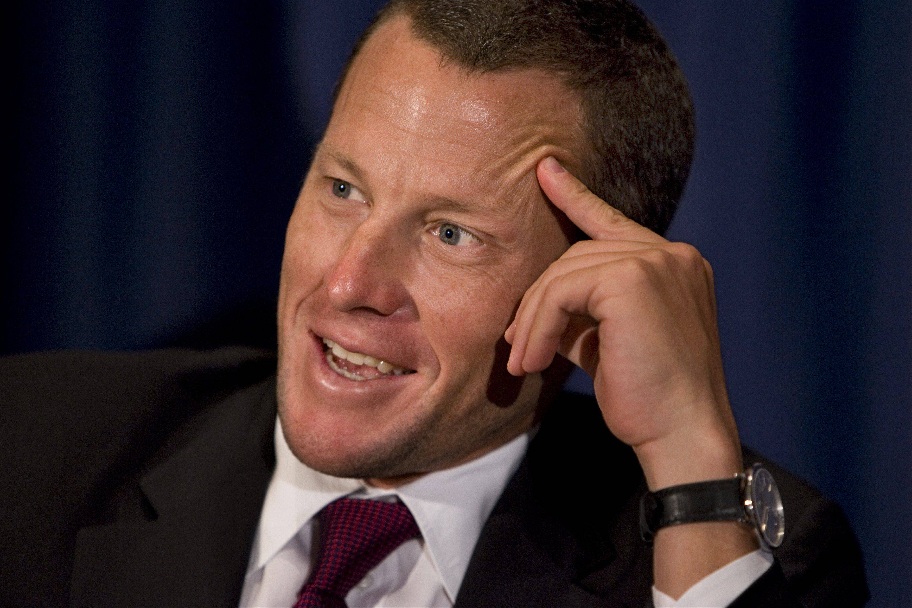 In this July 23, 2008 file photo, Lance Armstrong hosts a news conference at the National Press Club in Washington. Lance Armstrong will end his retirement and hopes to compete in the 2009 Tour de France, according to a cycling journal report. The 36-year-old seven-time Tour de France champion will compete in five road races with the Astana team in 2009, the cycling journal VeloNews reported on its Web site Monday Sept. 8, 2008, citing anonymous sources.