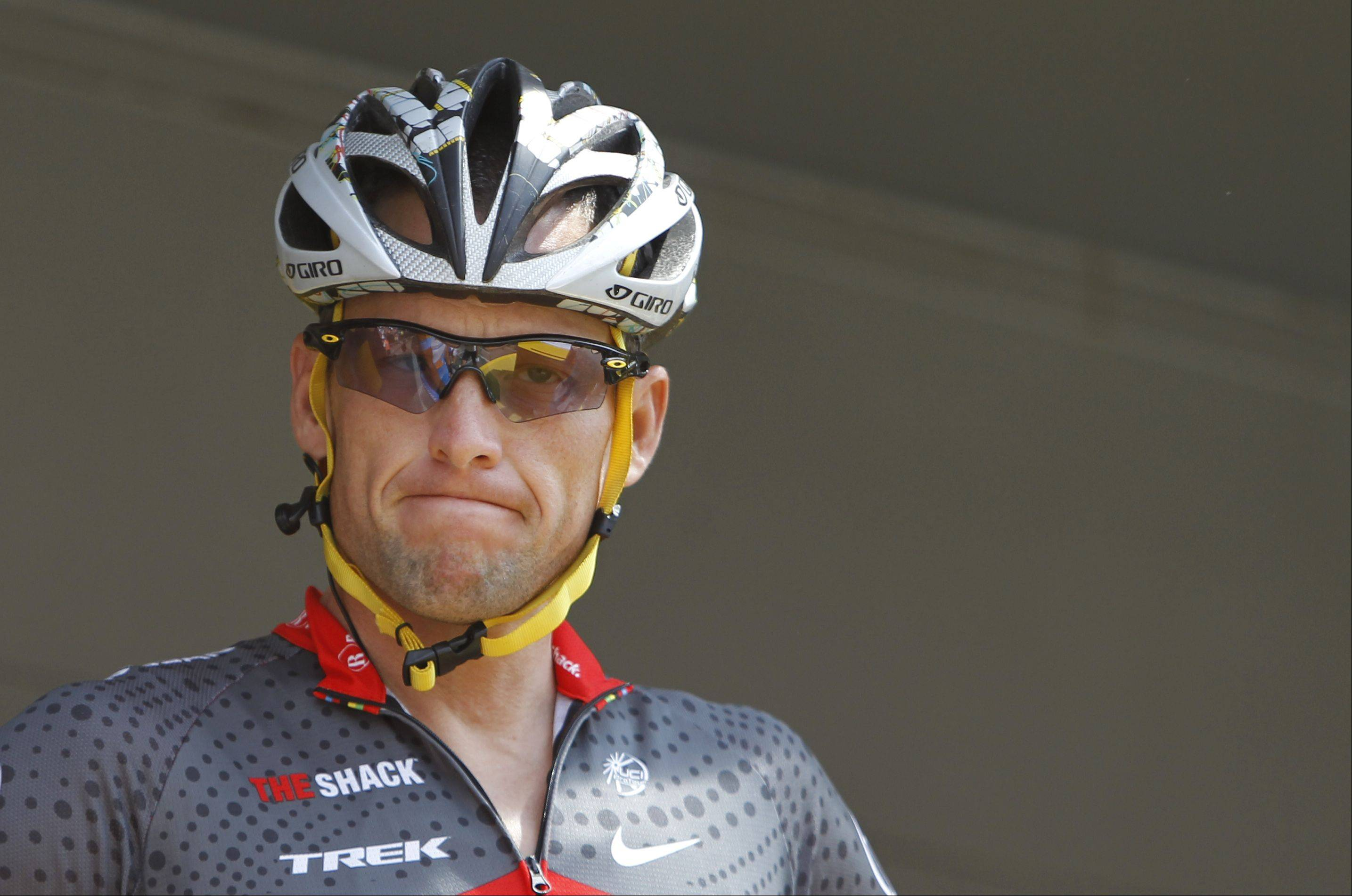 "This July 6, 2010, file photo shows Lance Armstrong grimacing prior to the start of the third stage of the Tour de France cycling race in Wanze, Belgium. Armstrong's attorneys say the U.S. Anti-Doping Agency is offering cyclists a ""sweetheart deal"" if they testify or provide evidence that the seven-time Tour de France winner cheated by doping."