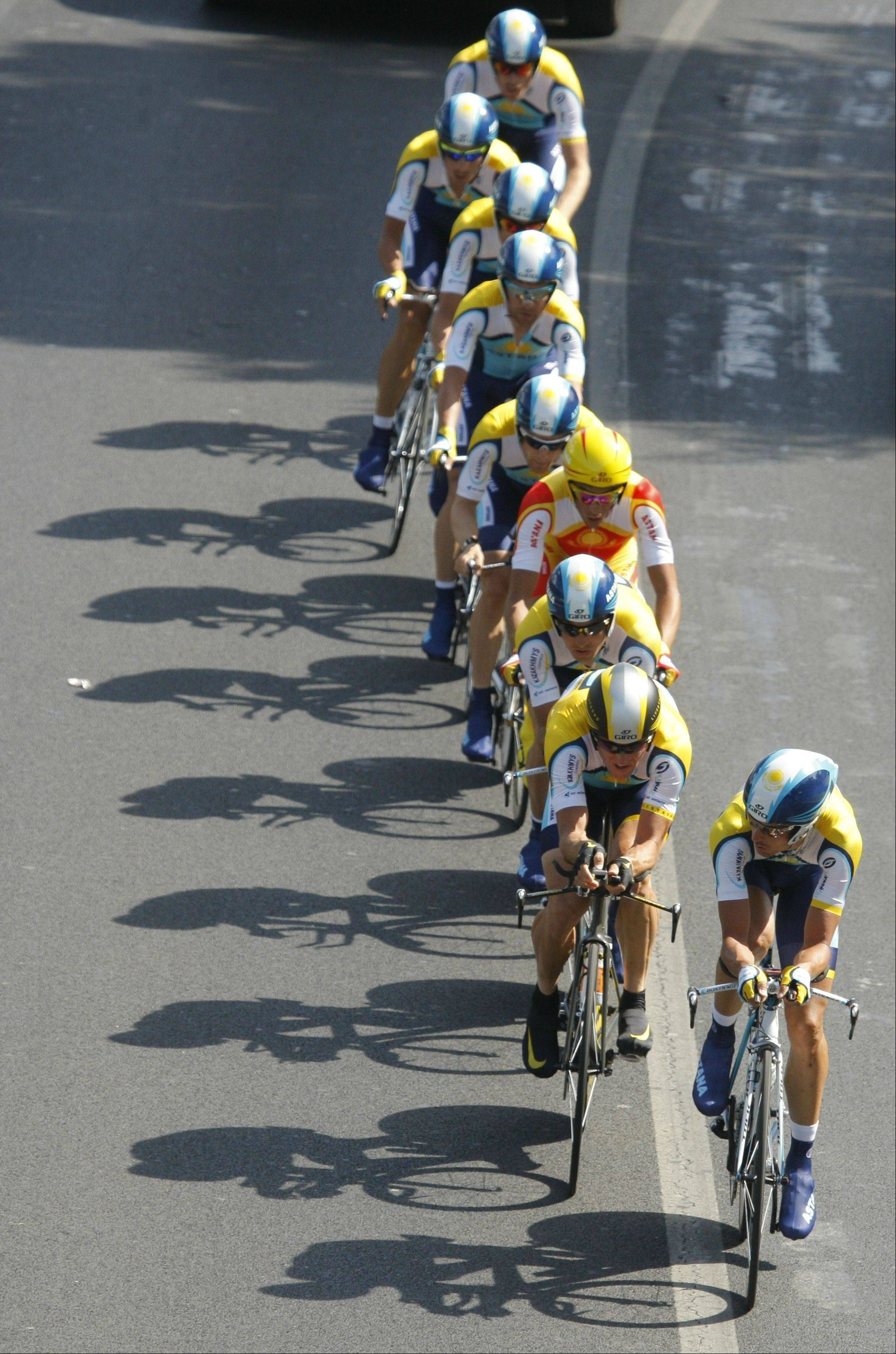 American seven-time Tour de France winner Lance Armstrong, second in row, rides with his Astana teammates during the fourth stage of the Tour de France cycling race, a team time-trial over 39 kilometers (24.2 miles) with start and finish in Montpellier, southern France, Tuesday July 7, 2009.