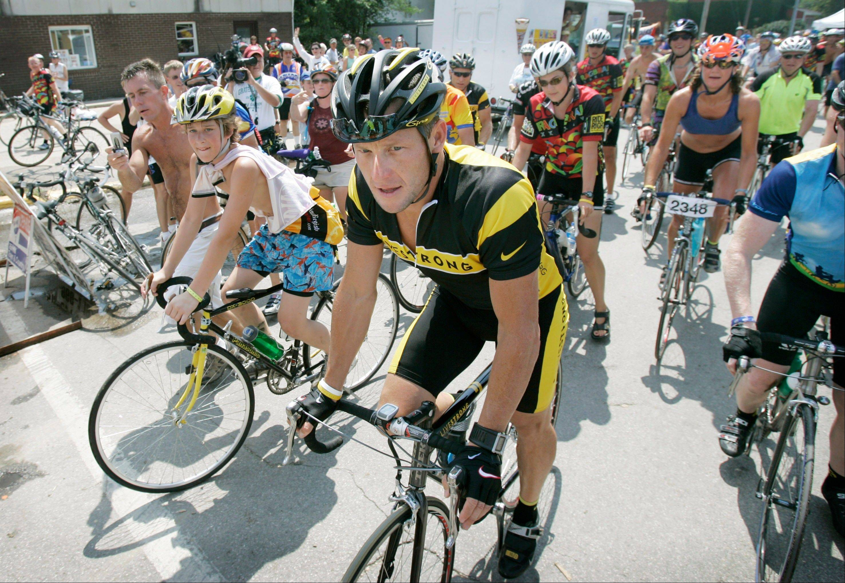 This July 26, 2006 file photo shows seven-time Tour de France winner Lance Armstrong as he heads out in Colfax, Iowa, with a group of riders during RAGBRAI, the Des Moines Register's Annual Great Bike Ride Across Iowa. The largest and oldest of the rides is the seven-day RAGBRAI, which takes 10,000 cyclists about 500 miles around Iowa's rolling hills every July.