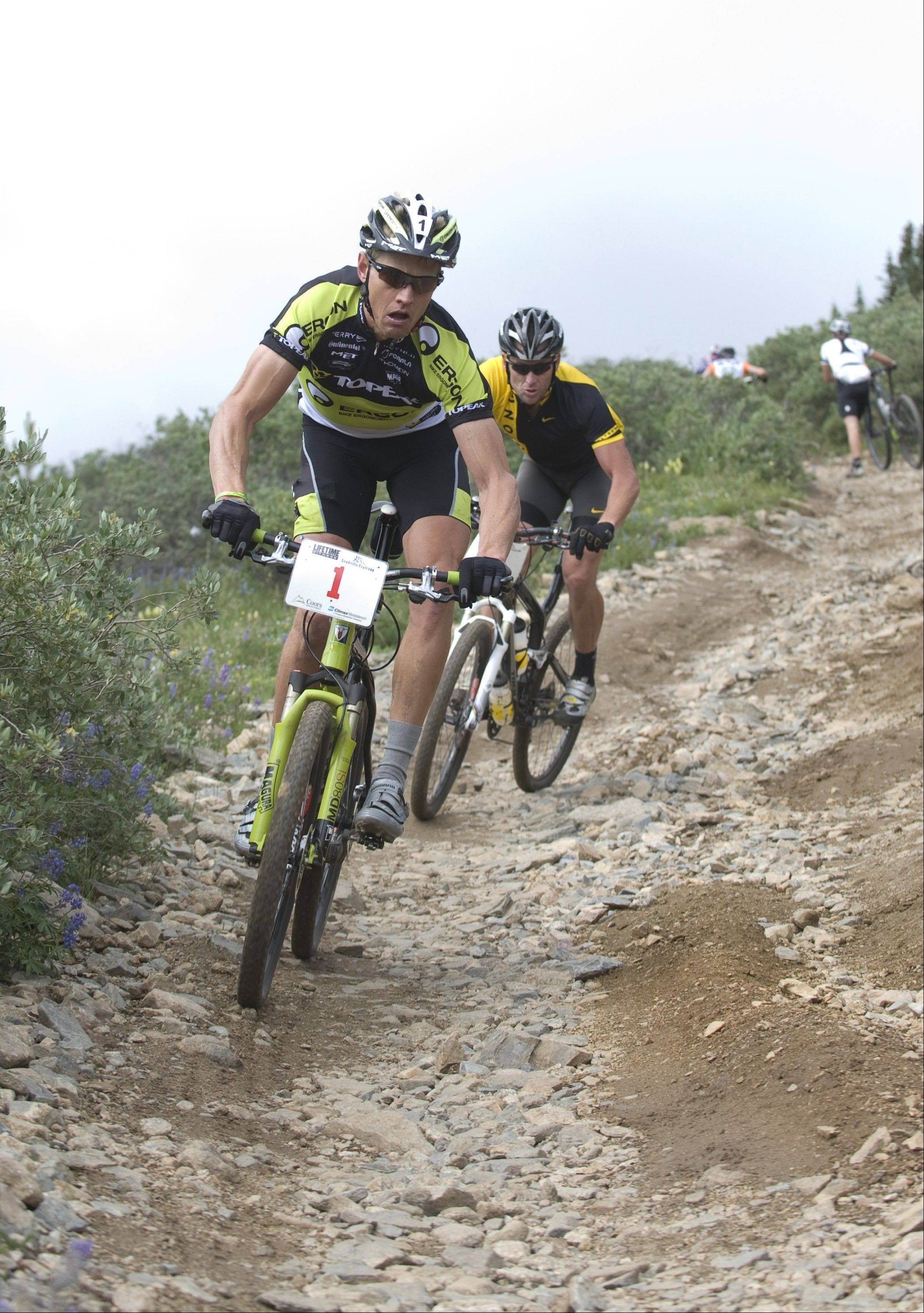 In this photo provided by Alex Fenlon, Dave Wiens, left, leads Lance Armstrong just after the halfway point of the Leadville 100 mountain bike race on Saturday, Aug. 9, 2008, in Leadville, Colo. Wiens went on to win the race, with Armstrong second.