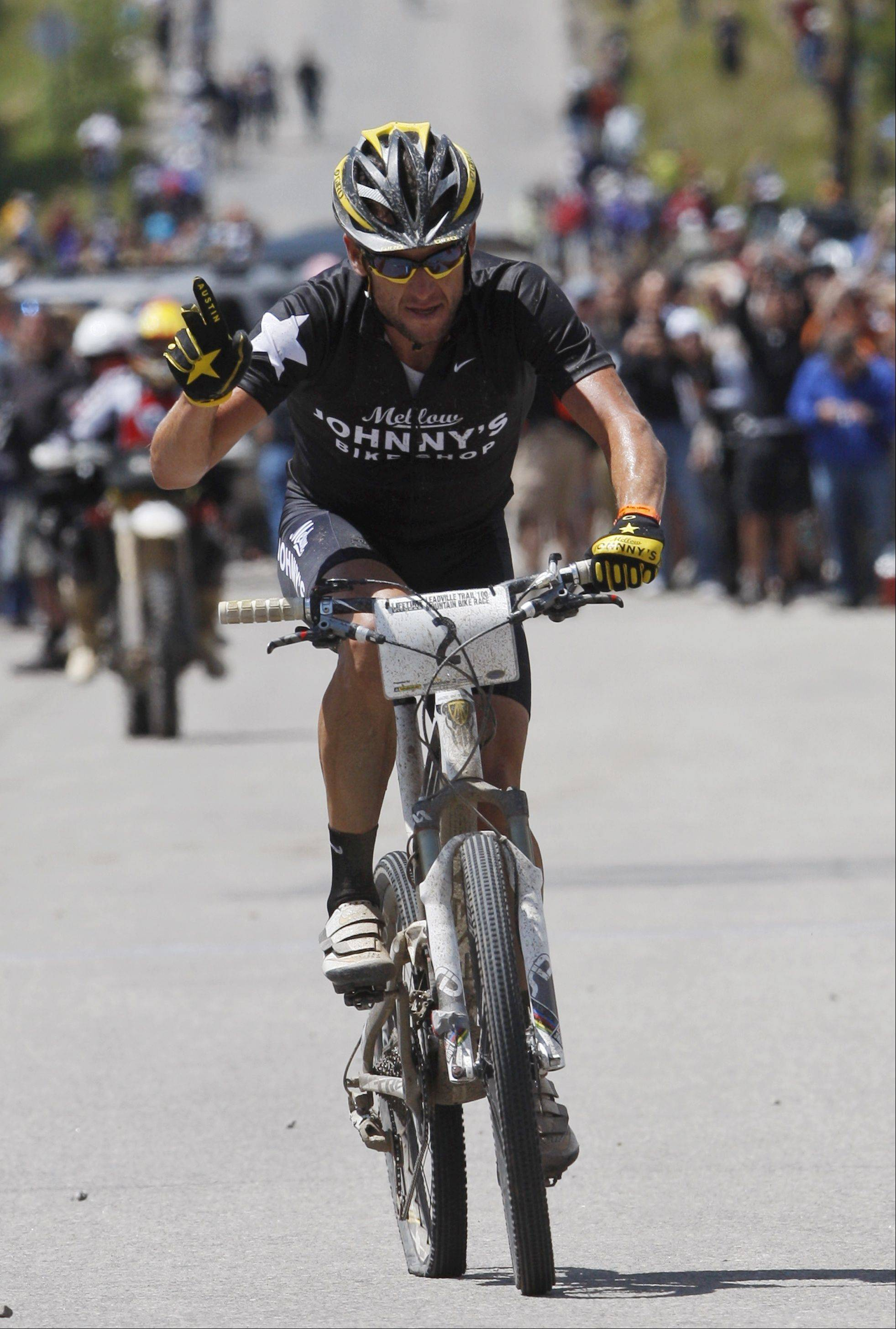 Lance Armstrong waves as he wins the Leadville Trail 100 mountain bike cycling race in Leadville, Colo., on Saturday, Aug. 15, 2009.