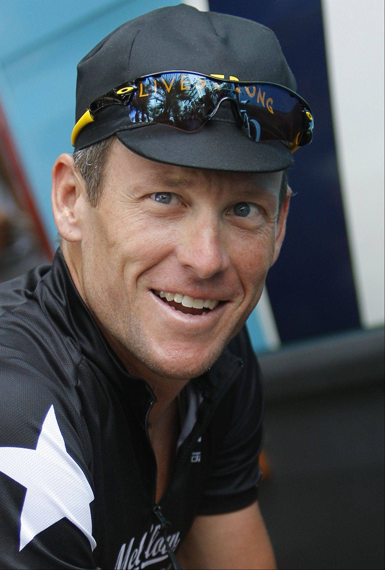 Lance Armstrong looks up as he prepares to leave for a training in Monaco Friday July 3, 2009, ahead of the start of the 96th edition of the Tour de France cycling race Saturday July 4, 2009.