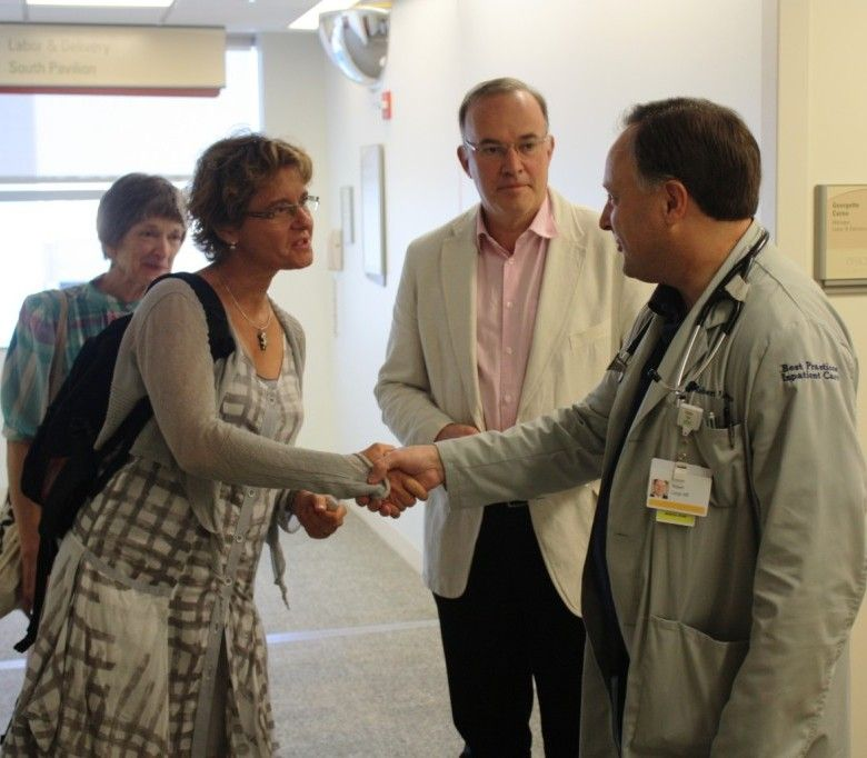 Northwest Community Hospiotal Medical Staff President Dr. Robert Longo welcomes French visitors Dr. Marie Mascle and her husband, Mayor Hugues Fourage of Fontenay le Comte, France.