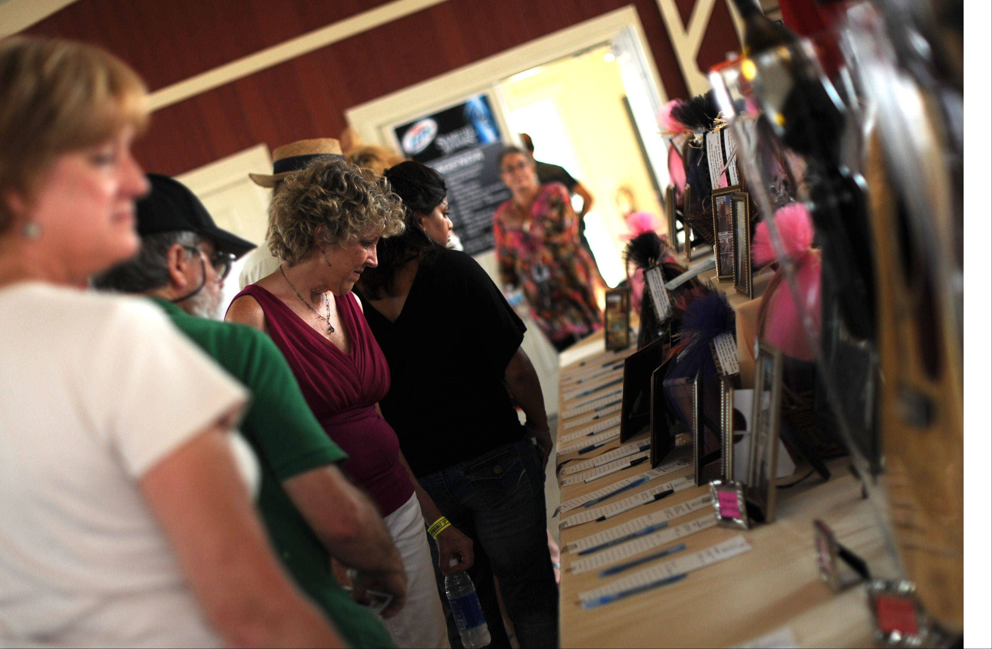 Attendees browse the silent auction offerings at the Paul Ruby Foundation's sixth annual Concert for a Cure at Tanna Farms Golf Club in Geneva Saturday. Proceeds benefit Parkinson's disease research.