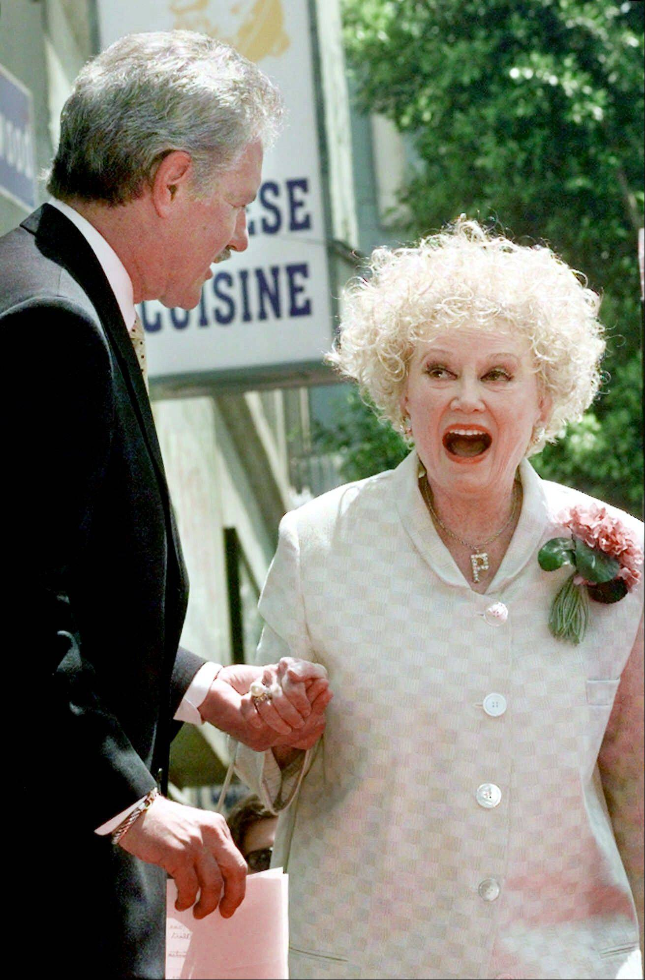 Associated Press/May 17, 1999 Emmy award winning game show host, Alex Trebek greets actress and comedian Phyllis Diller before receiving his newly-dedicated star on the Hollywood Walk of Fame in the Hollywood section of Los Angeles.