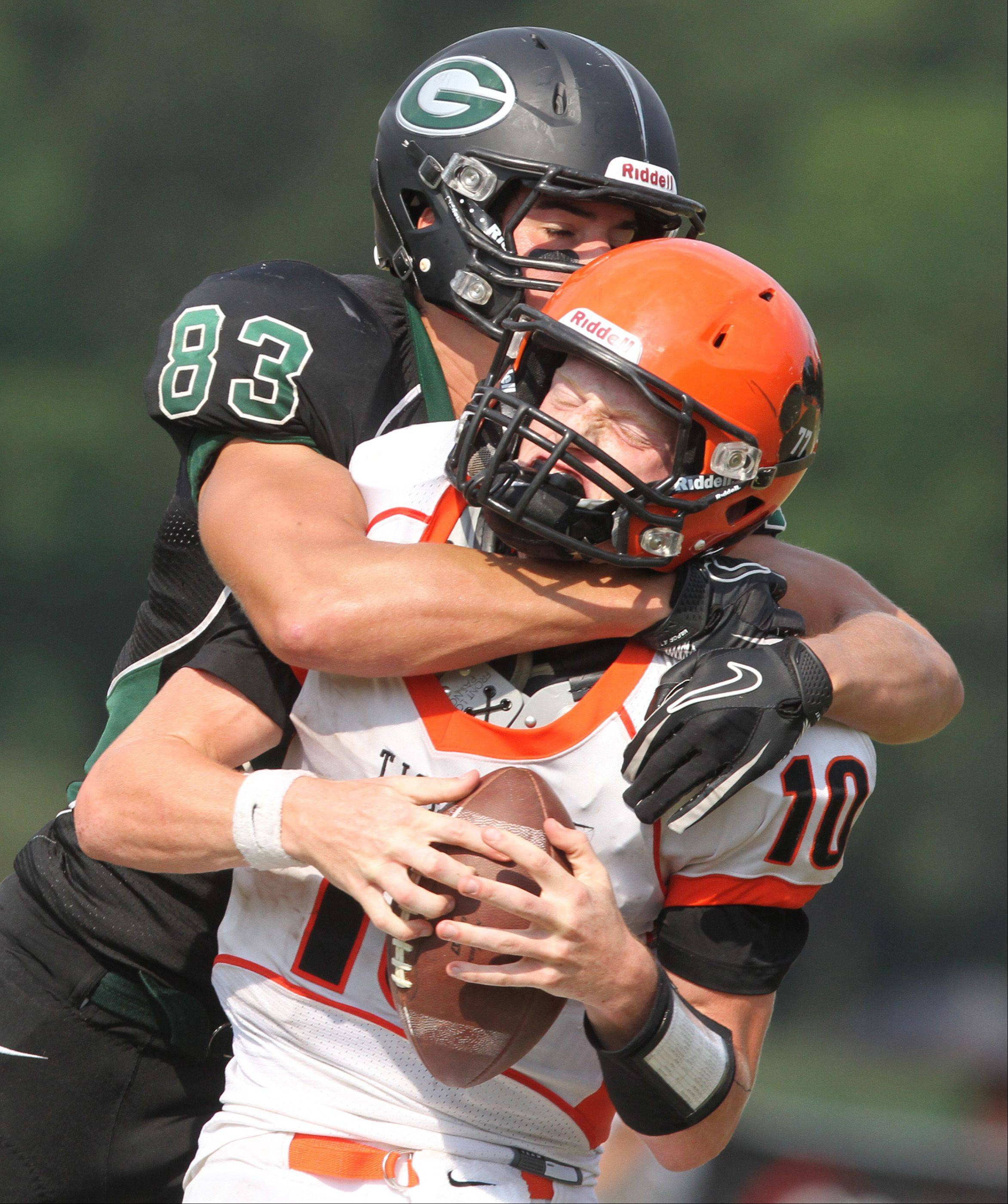 George LeClaire/gleclaire@dailyherald.com Glenbard West tight end Nathan Marcus sacks Wheaton Warrenville South quarterback Ryan Graham in the third-quarter on fourth down with 13-yards to go at Glenbard West on Saturday, August 25.