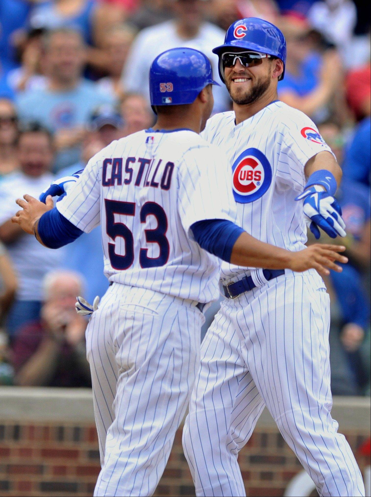 The Cubs' Brett Jackson right, celebrates with Welington Castillo after hitting a 2-run homer against the Rockies in the fourth inning Saturday. Jackson homered for the second straight game and had his third multihit game.