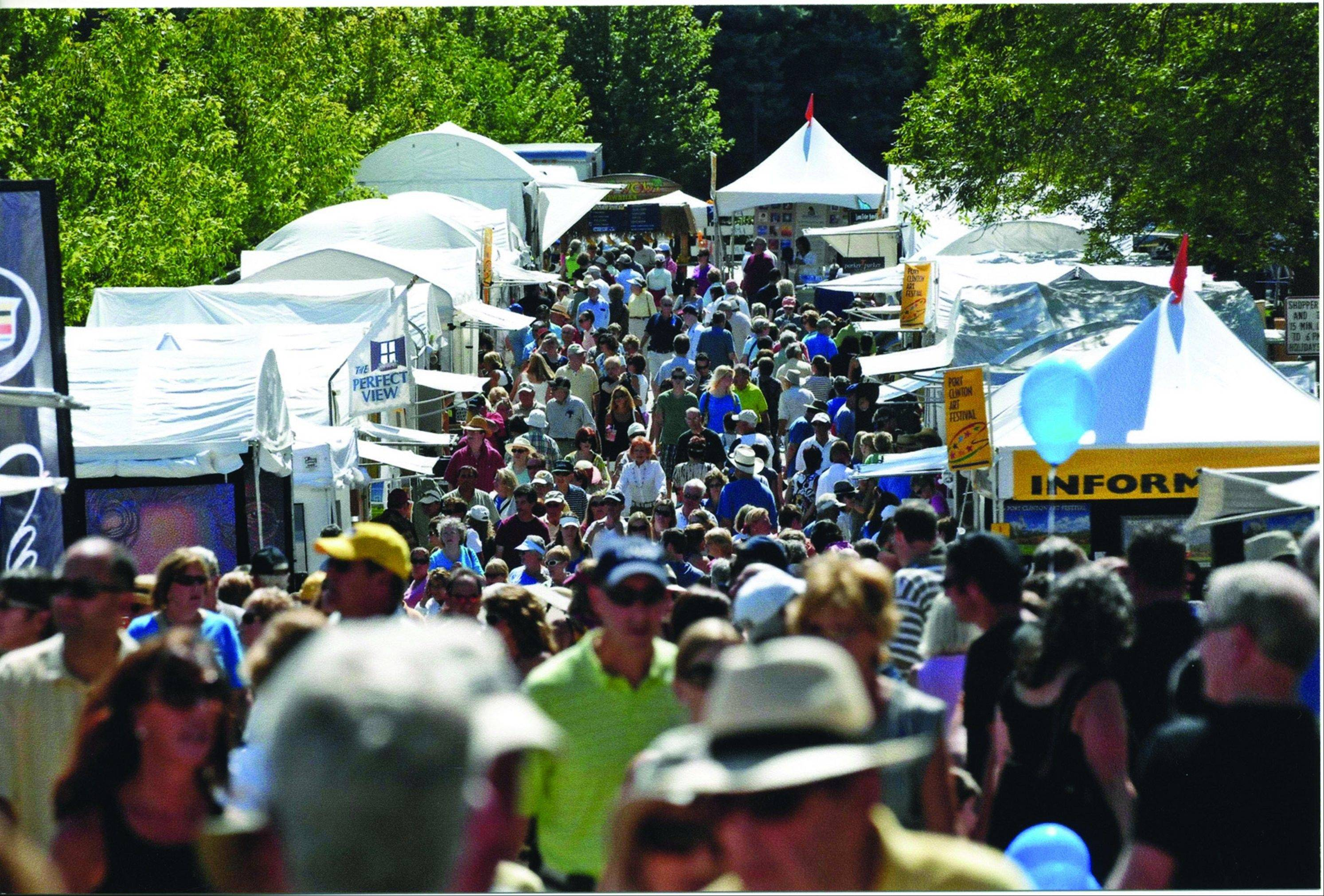 Daily Herald file photoThousands of art fans flock to the annual outdoor Port Clinton Art Festival in Highland Park.