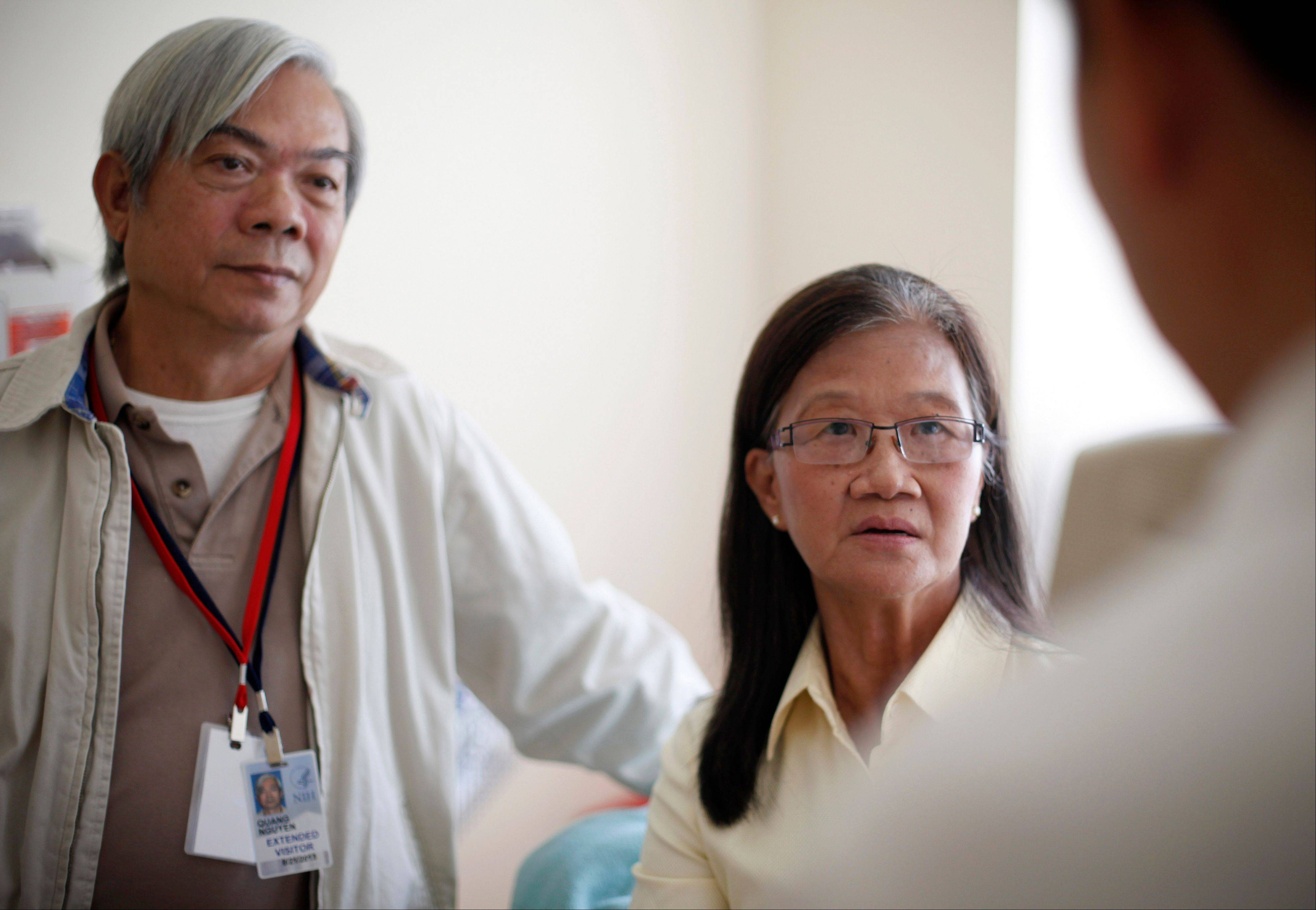 Patient Kim Nguyen, right, and her husband Quang Nguyen at the National Institutes of Health in Bethesda, Md. Researchers have identified a mysterious new disease that has left scores of people in Asia and some in the United States with AIDS-like symptoms even though they are not infected with HIV.