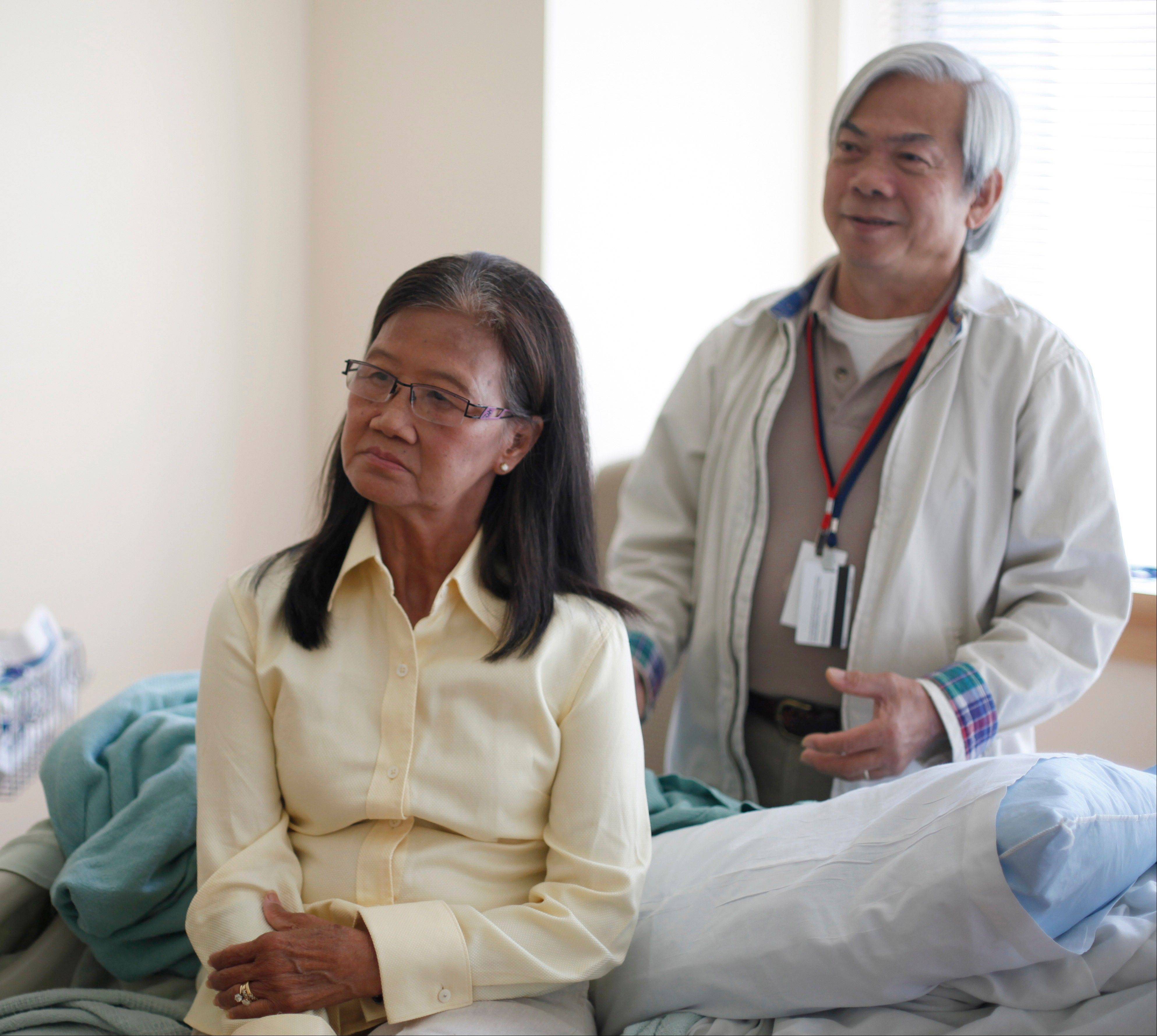 Patient Kim Nguyen, left, and her husband Quang Nguyen are trying to seek answers for a mysterious illness at the National Institutes of Health in Bethesda, Md. Researchers have identified a new disease that has left scores of people in Asia and some in the United States with AIDS-like symptoms even though they are not infected with HIV.