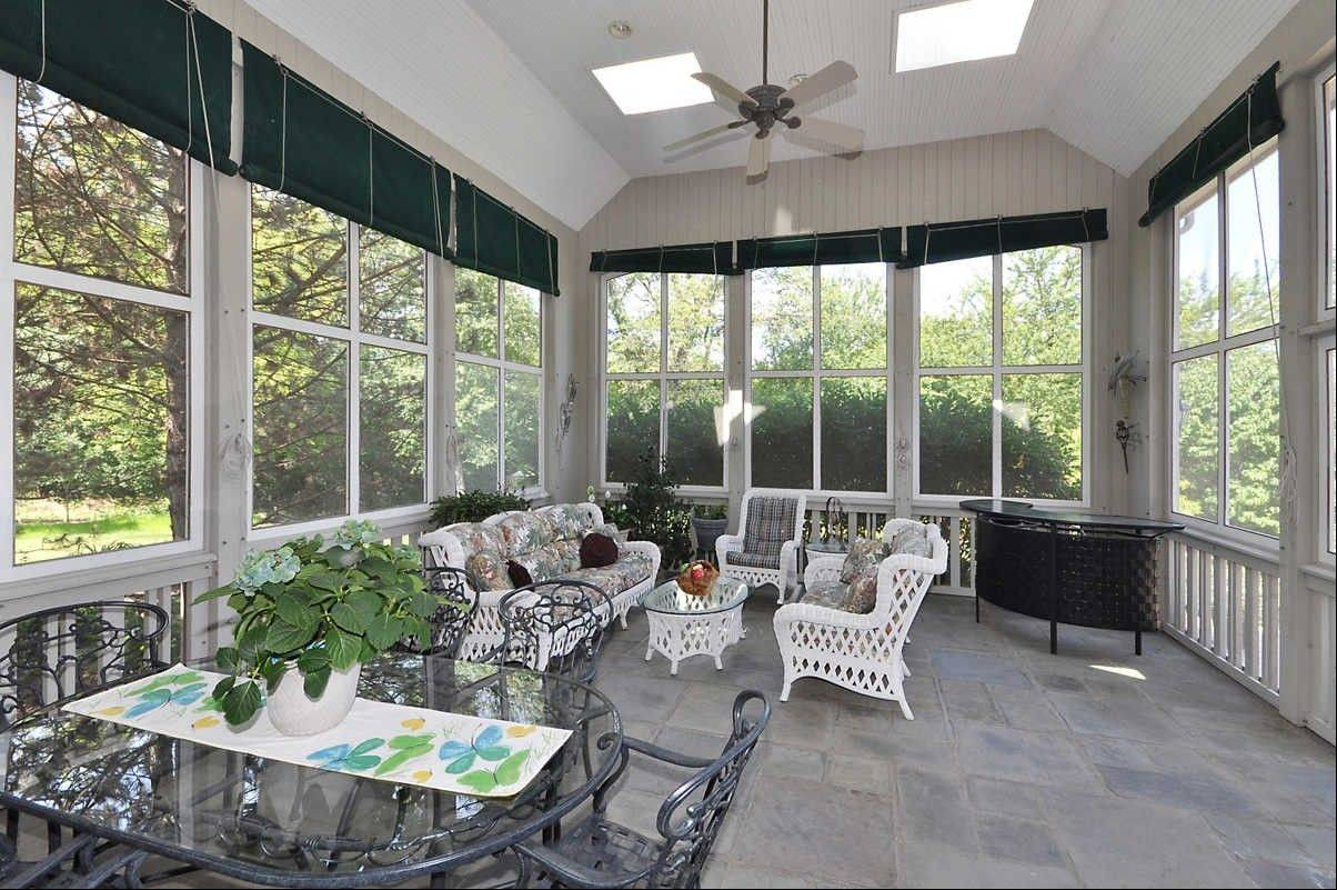 The screened porch is one of the many areas in the home ideal for entertaining.