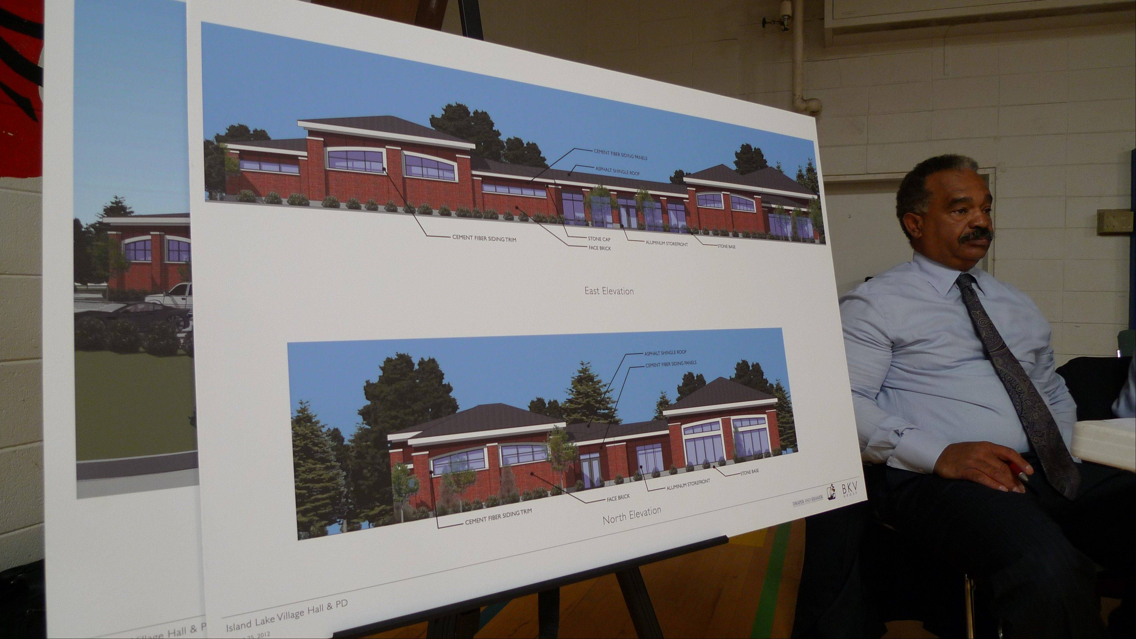 Wayne L. Pierce, managing director at Stern Brothers & Co., sits next to a drawing of a proposed new municipal center Saturday in Island Lake.$PHOTOCREDIT_ON$$PHOTOCREDIT_OFF$$PHOTOCREDIT_ON$Dann Gire/ dgire@dailyherald.com$PHOTOCREDIT_OFF$