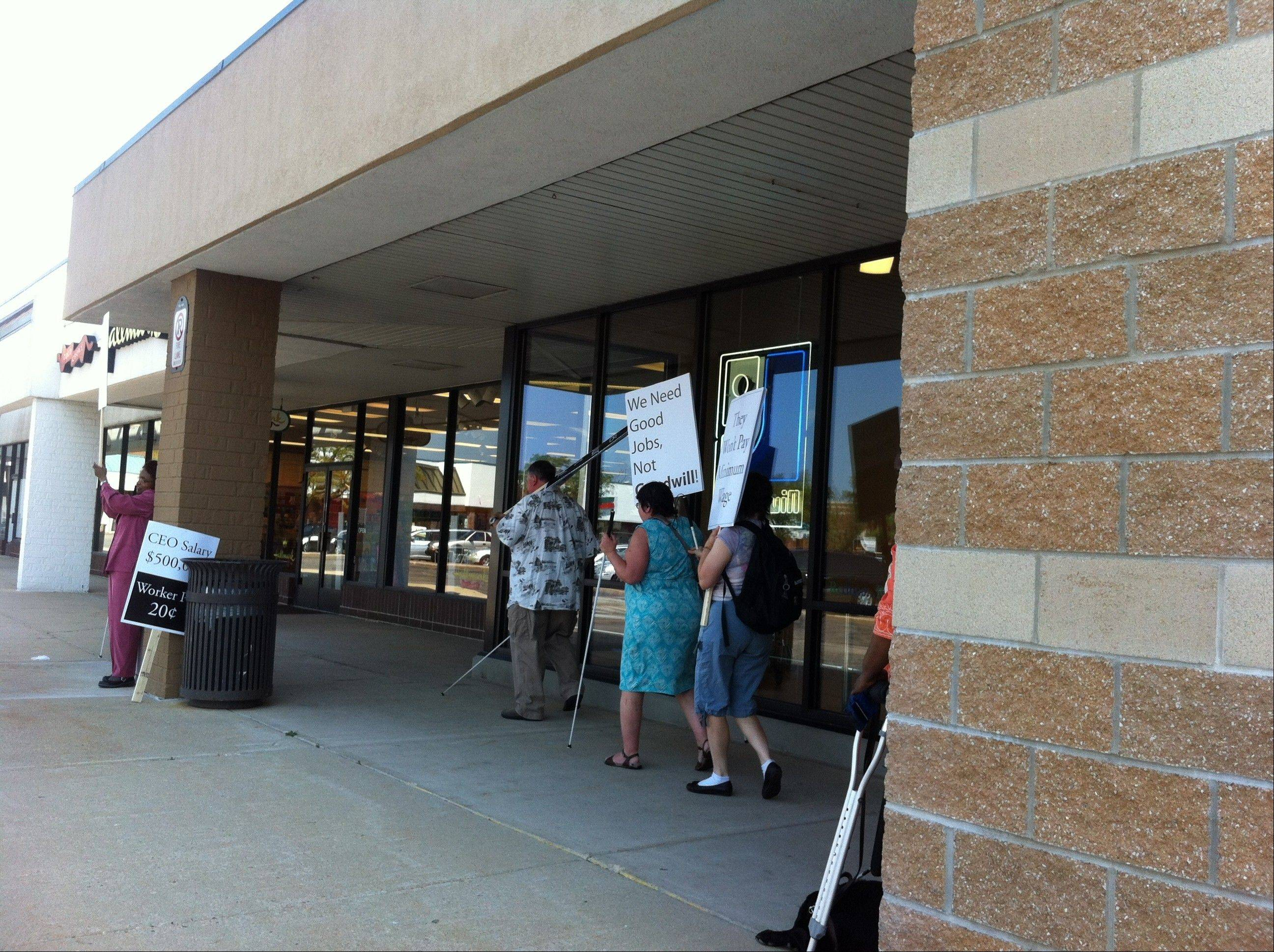 Protesters from the National Federation of the Blind of Illinois march outside the Des Plaines Goodwill Store and Donation Center for what they say are unfair wages paid to some employees.