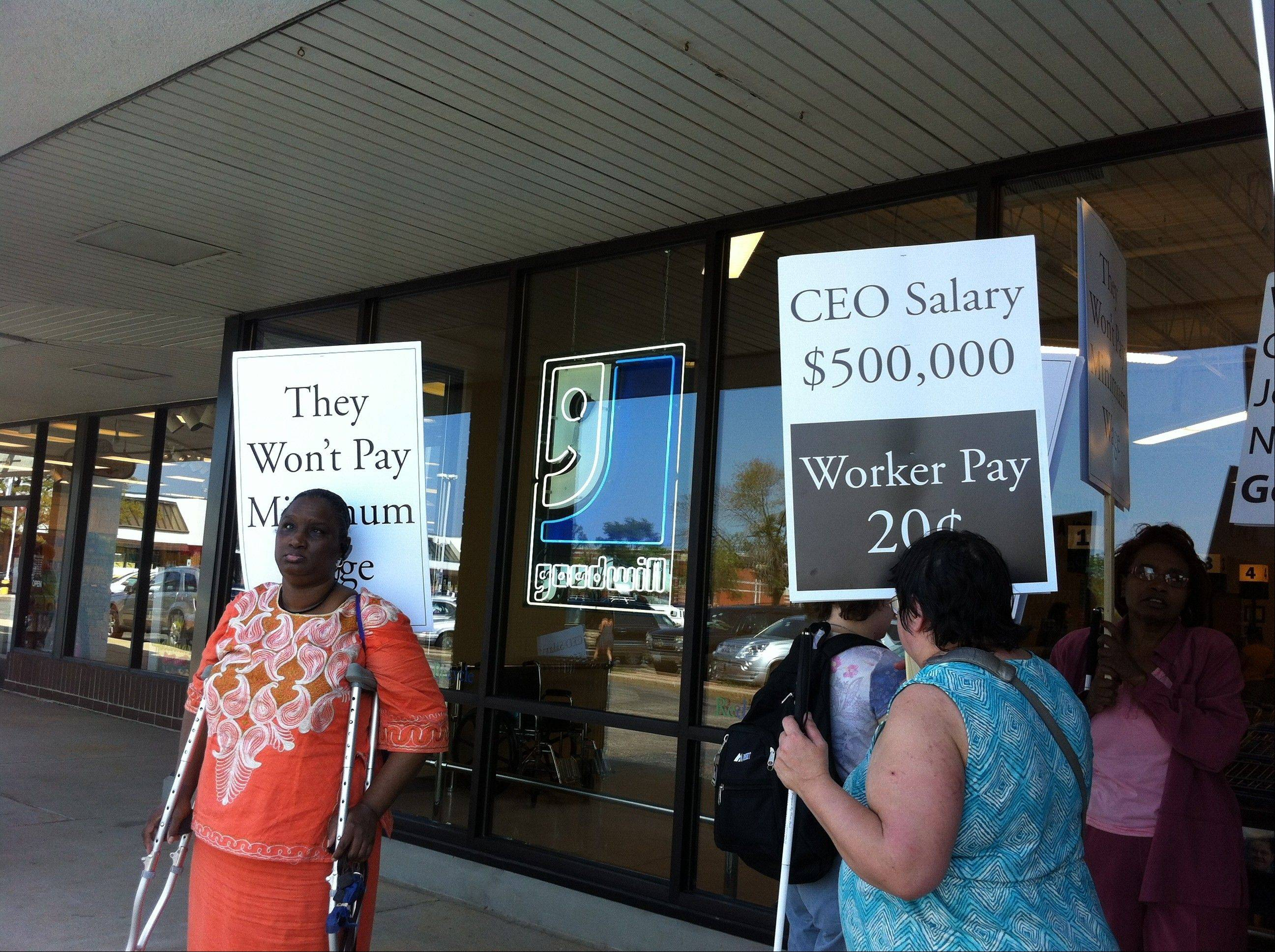 Protesters from the National Federation of the Blind of Illinois march outside the Des Plaines Goodwill Store and Donation Center on Saturday for what they say are unfair wages paid to some employees.