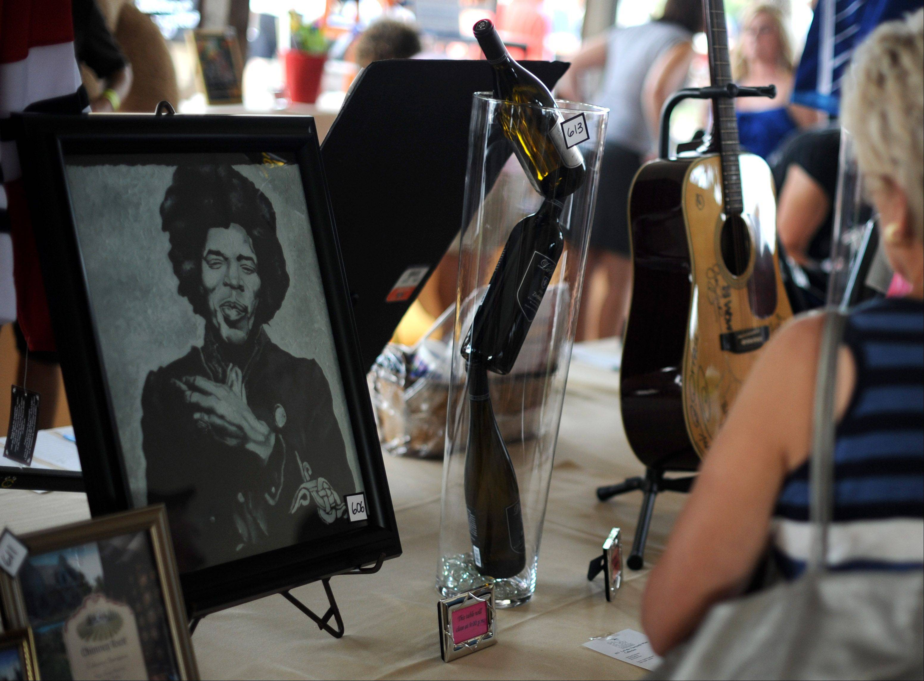 A Jimi Hendrix print was one of many different items up for auction during the Paul Ruby Foundation's sixth annual Concert for a Cure Saturday at Tanna Farms Golf Club in Geneva.