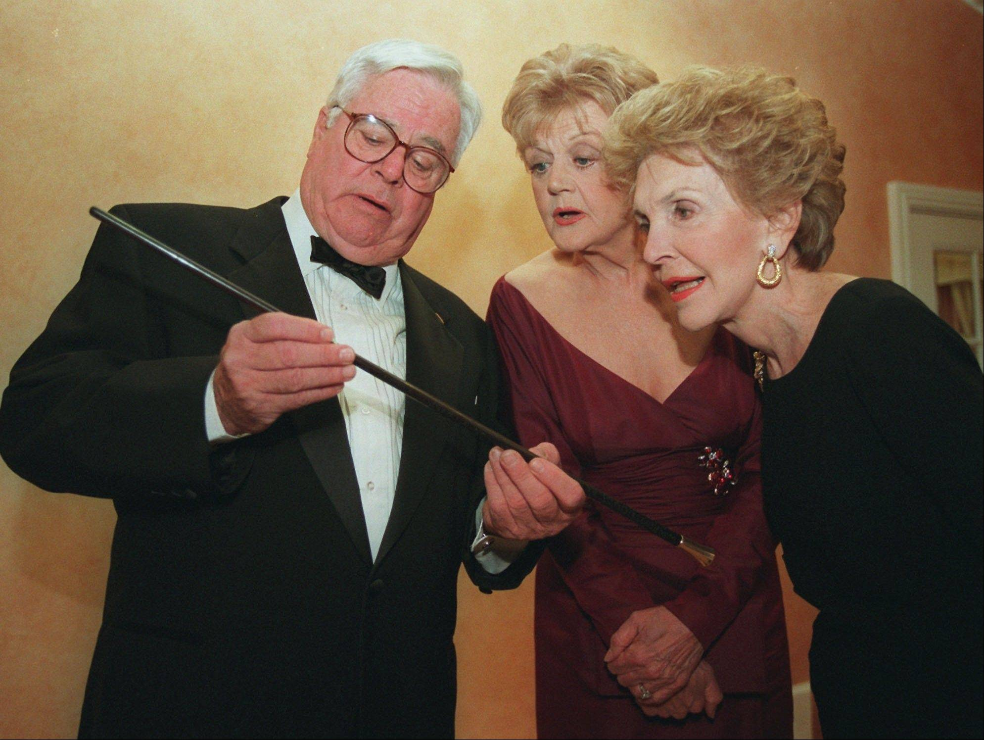 "Associated Press/March 23, 1996William Windom, left, shows a swagger stick to ""Murder She Wrote"" star Angela Lansbury, center, and former first lady Nancy Reagan prior to Lansbury being presented the Caritas Award by Mrs. Reagan in Beverly Hills, Calif."