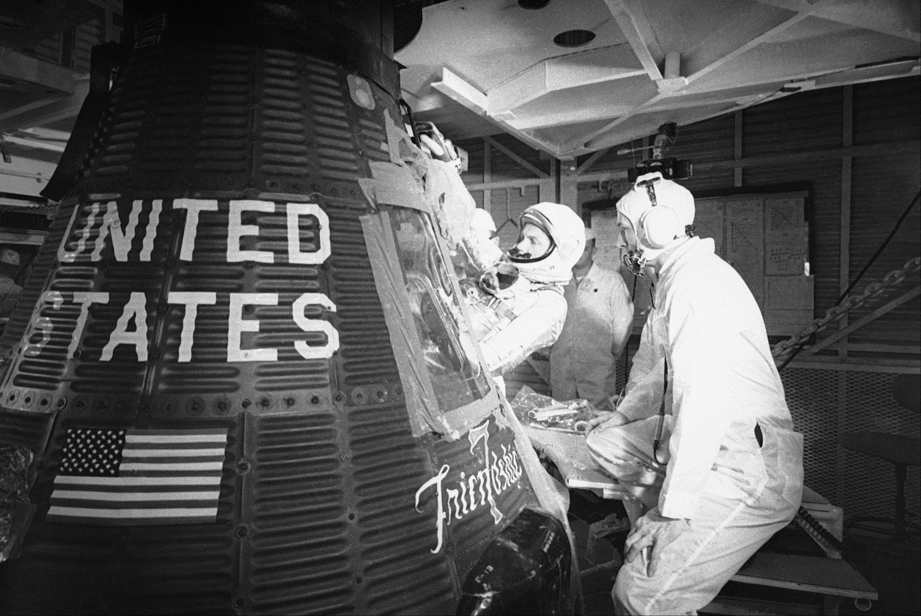 "In this Jan. 2, 1962 file picture, astronaut John Glenn climbs into the ""Friendship 7"" Mercury capsule at Cape Canaveral, Fla. The family of Neil Armstrong, the first man to walk on the moon, says he has died at age 82. A statement from the family says he died following complications resulting from cardiovascular procedures. It doesn't say where he died. Armstrong commanded the Apollo 11 spacecraft that landed on the moon July 20, 1969. He radioed back to Earth the historic news of ""one giant leap for mankind."" Armstrong and fellow astronaut Edwin ""Buzz"" Aldrin spent nearly three hours walking on the moon, collecting samples, conducting experiments and taking photographs. In all, 12 Americans walked on the moon from 1969 to 1972."