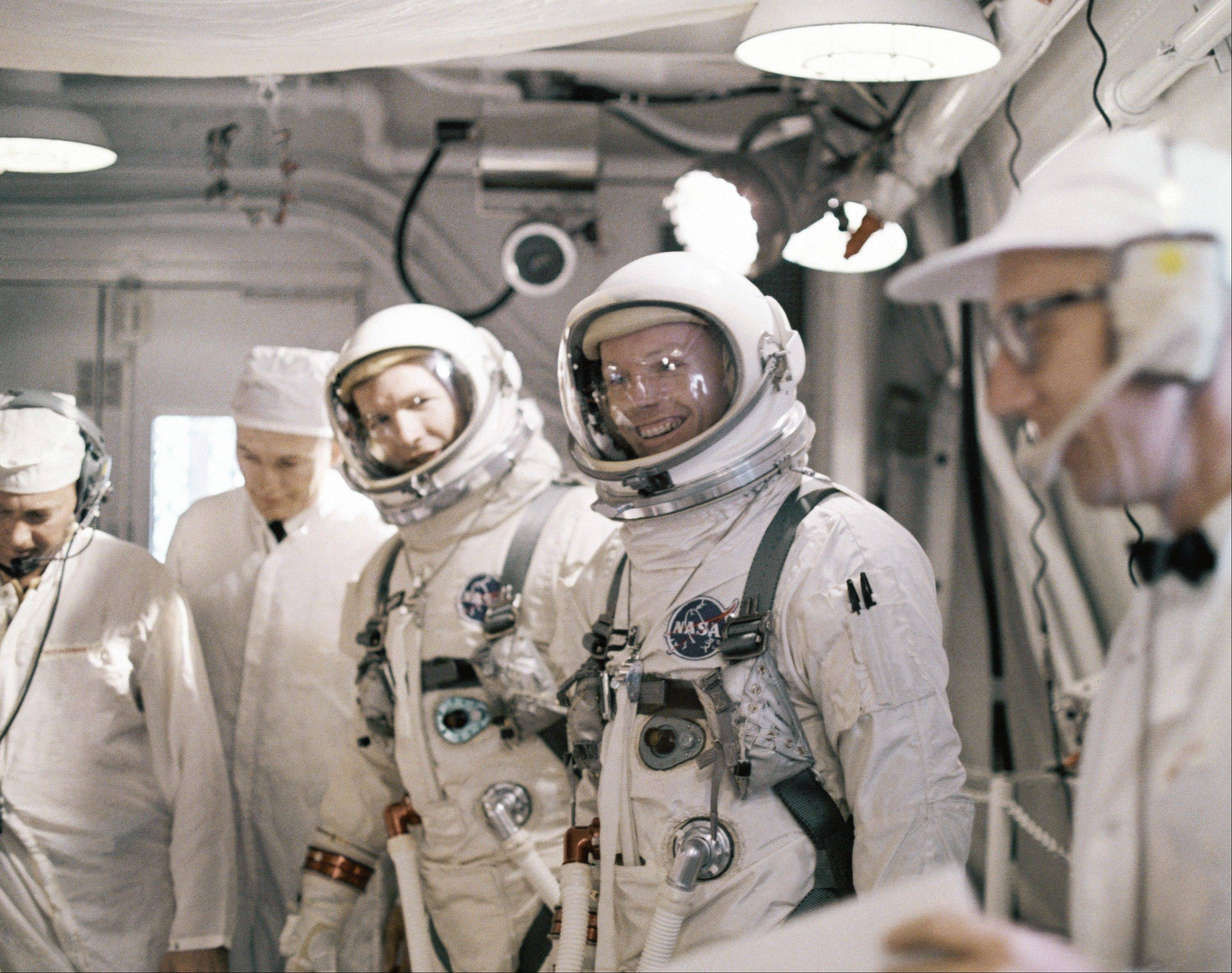 "In this March 16, 1966 file photo Astronauts Neil A. Armstrong and David R. Scott arrive, March 16, 1966 at Complex 19 for a simulated test in preparation for flight. The family of Neil Armstrong, the first man to walk on the moon, says he has died at age 82. A statement from the family says he died following complications resulting from cardiovascular procedures. It doesn't say where he died. Armstrong commanded the Apollo 11 spacecraft that landed on the moon July 20, 1969. He radioed back to Earth the historic news of ""one giant leap for mankind."" Armstrong and fellow astronaut Edwin ""Buzz"" Aldrin spent nearly three hours walking on the moon, collecting samples, conducting experiments and taking photographs. In all, 12 Americans walked on the moon from 1969 to 1972."