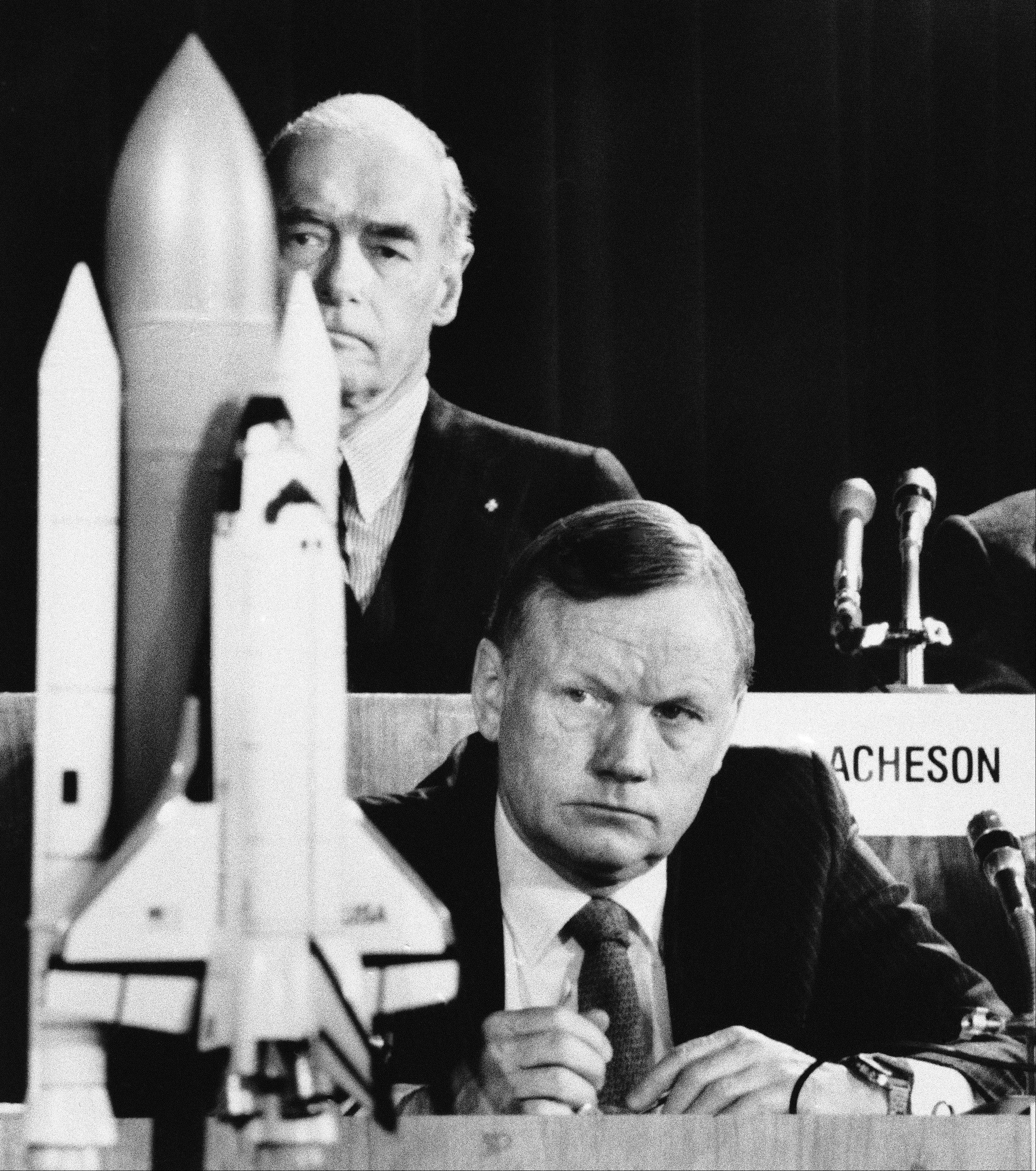 "In this Feb. 11, 1986 file photo, former astronaut Neil Armstrong, a member of the presidential panel investigating the Space Shuttle Challenger explosion, listens to testimony before the commission in Washington, David Acheson, a commission member, listens in the background. A model of the shuttle sits on the table. The family of Neil Armstrong, the first man to walk on the moon, says he has died at age 82. A statement from the family says he died following complications resulting from cardiovascular procedures. It doesn't say where he died. Armstrong commanded the Apollo 11 spacecraft that landed on the moon July 20, 1969. He radioed back to Earth the historic news of ""one giant leap for mankind."" Armstrong and fellow astronaut Edwin ""Buzz"" Aldrin spent nearly three hours walking on the moon, collecting samples, conducting experiments and taking photographs. In all, 12 Americans walked on the moon from 1969 to 1972."