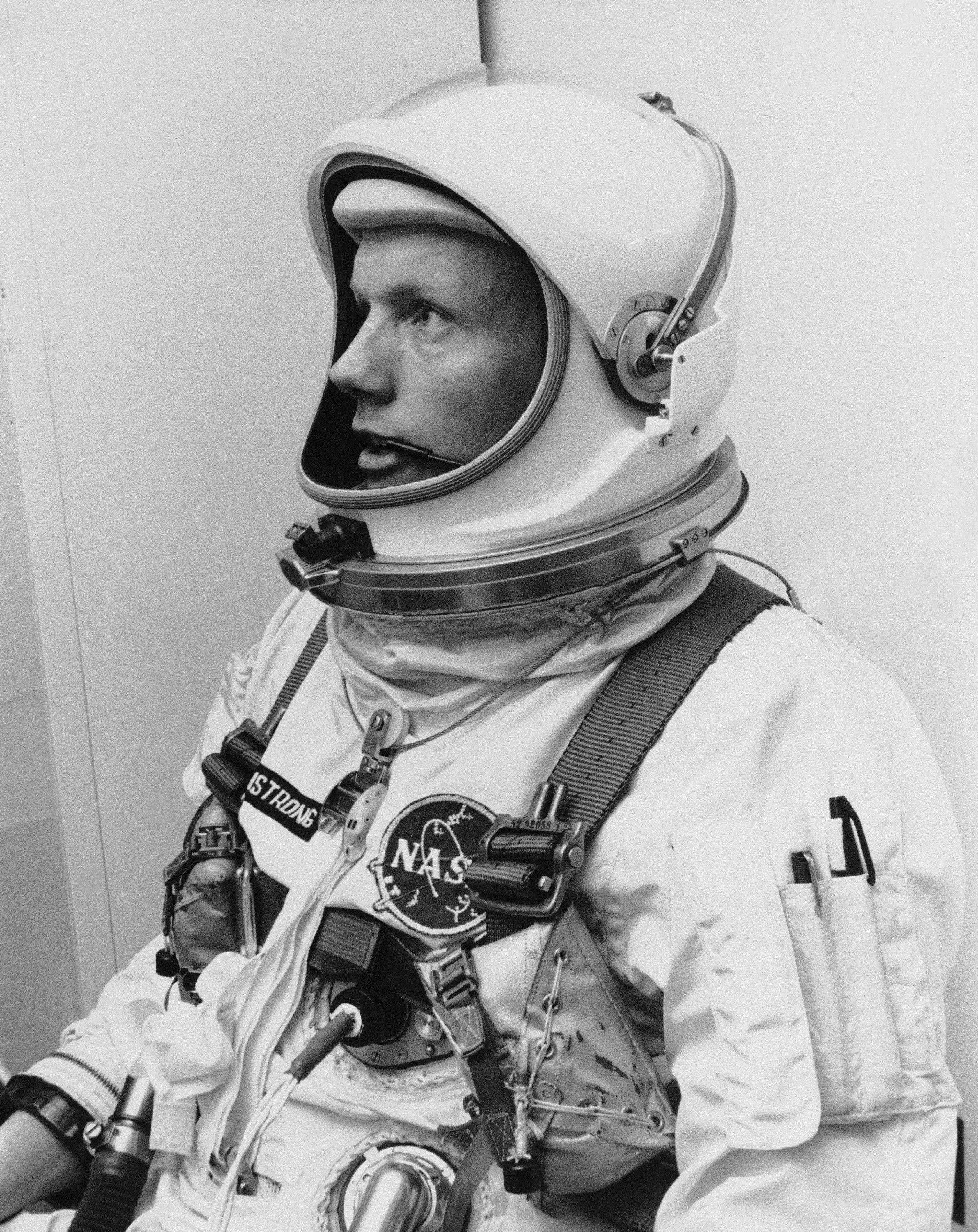 "In this March 6, 1966 file photo Astronaut Neil Armstrong, pilot for the Gemini VIII mission is shown. The family of Neil Armstrong, the first man to walk on the moon, says he has died at age 82. A statement from the family says he died following complications resulting from cardiovascular procedures. It doesn't say where he died. Armstrong commanded the Apollo 11 spacecraft that landed on the moon July 20, 1969. He radioed back to Earth the historic news of ""one giant leap for mankind."" Armstrong and fellow astronaut Edwin ""Buzz"" Aldrin spent nearly three hours walking on the moon, collecting samples, conducting experiments and taking photographs. In all, 12 Americans walked on the moon from 1969 to 1972."