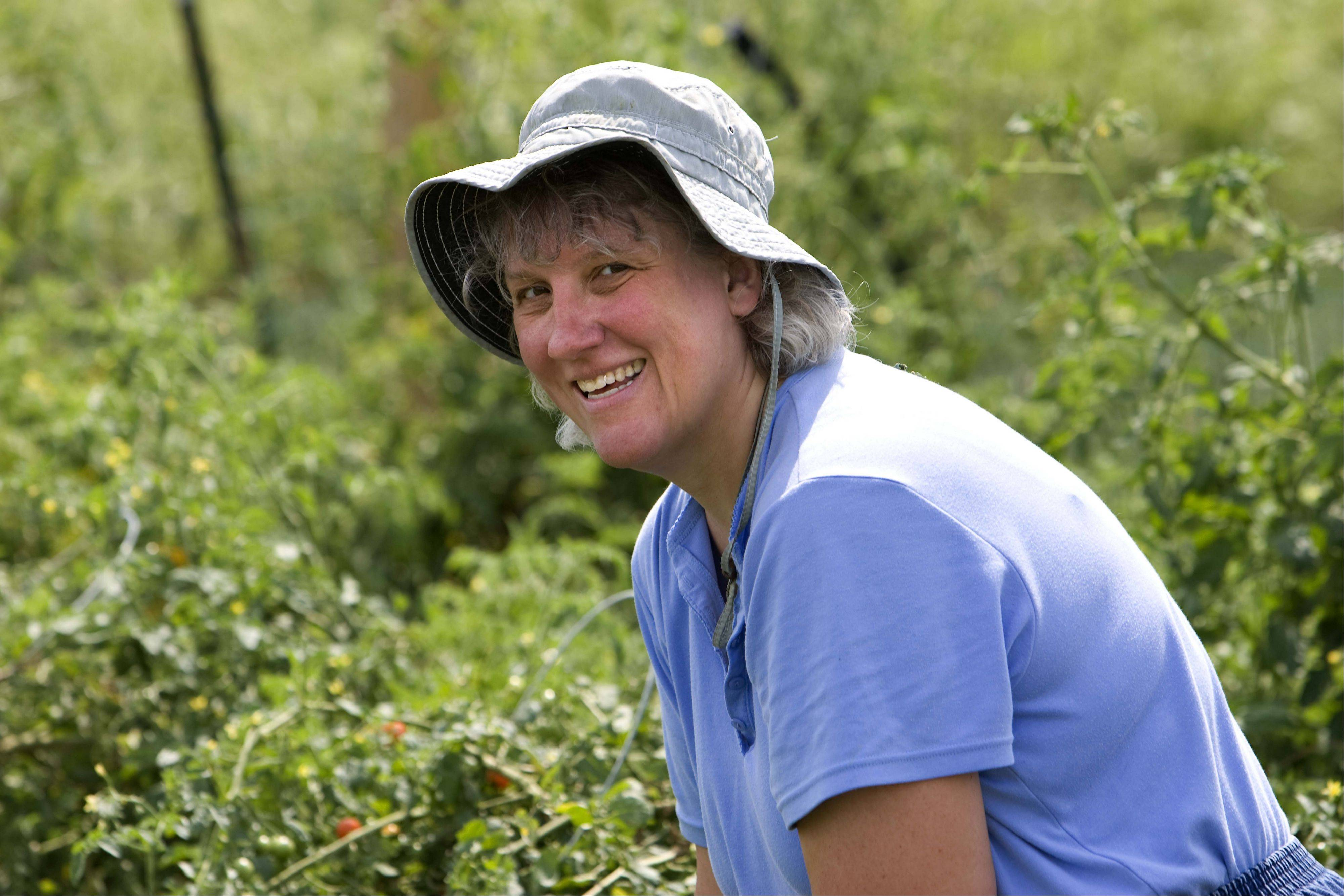Daily Herald staff writer Susan Sarkauskas has logged many hours this summer in her plot at the Community Garden in Geneva.