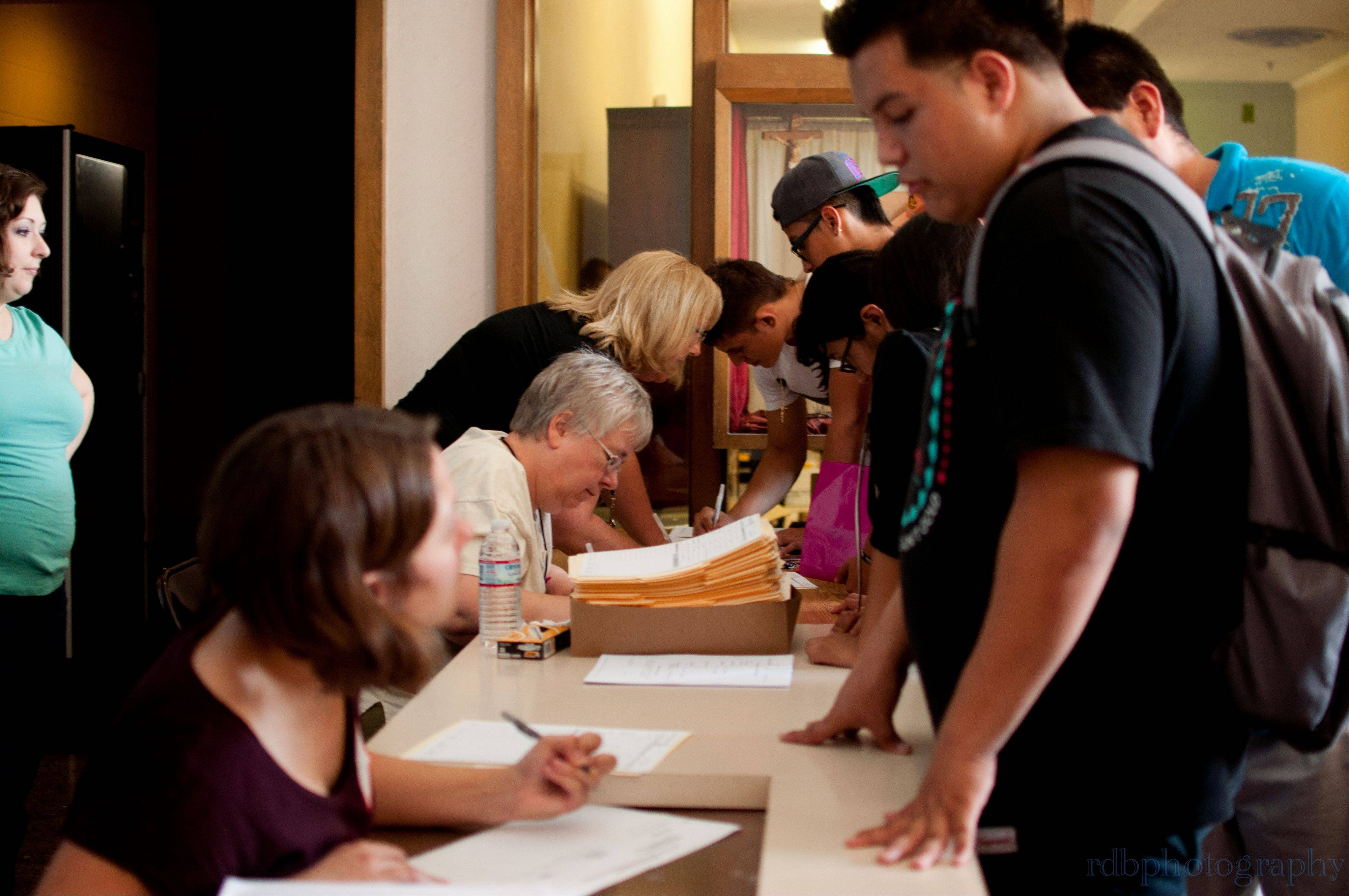 If illegal immigrants qualified for the federal program, volunteers helped them assemble the application paperwork Friday afternoon.