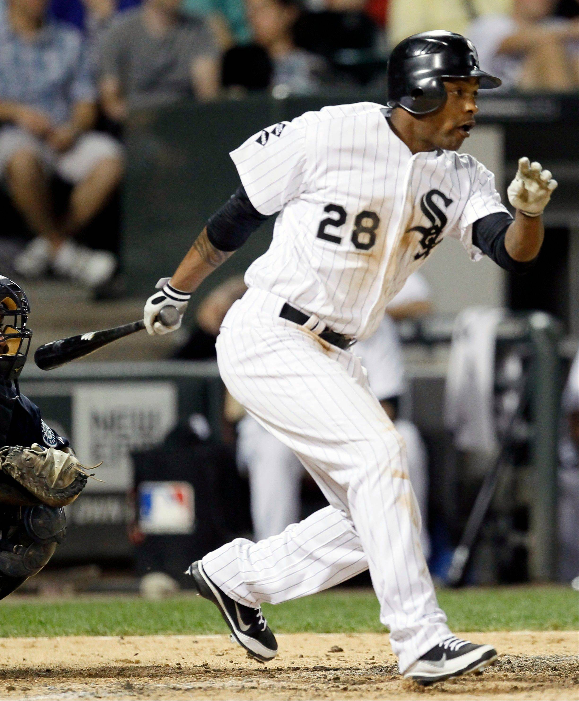 Chicago White Sox's Dewayne Wise hits an RBI-single, scoring Alexei Ramirez and breaking a 3-3 tie, off Seattle Mariners relief pitcher Charlie Furbush during the sixth inning of a baseball game on Saturday, Aug. 25, 2012, in Chicago.