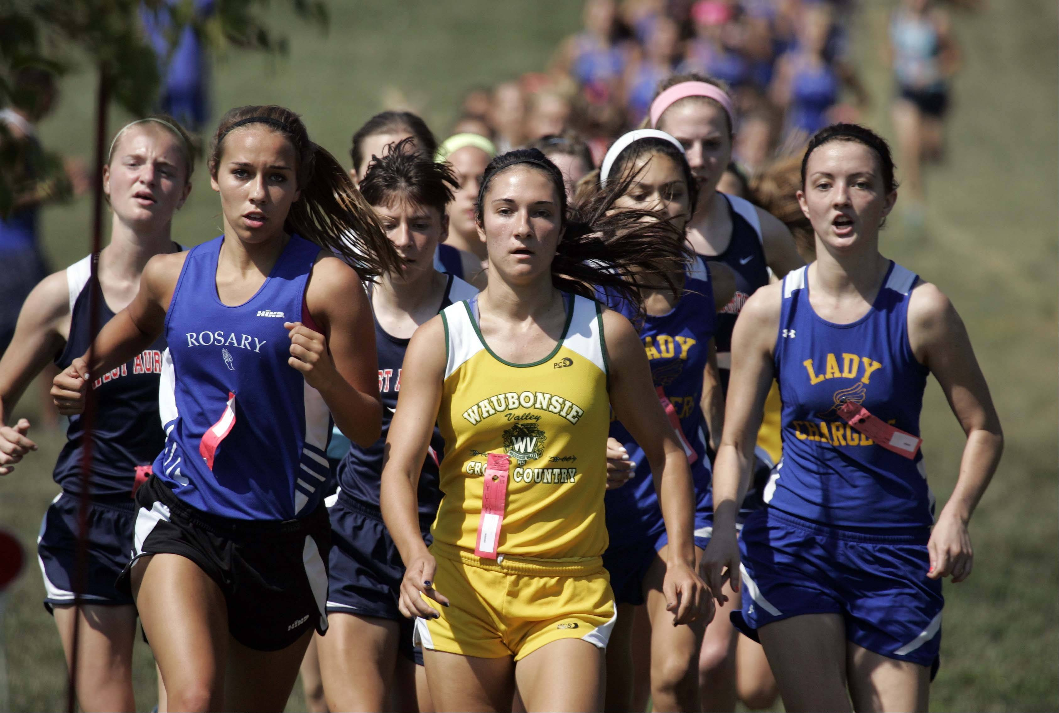 Waubonsie Valley's Ashley Bruner, center, on her way to victory at the Aurora girls cross county meet at Marmion Saturday August 25, 2012.