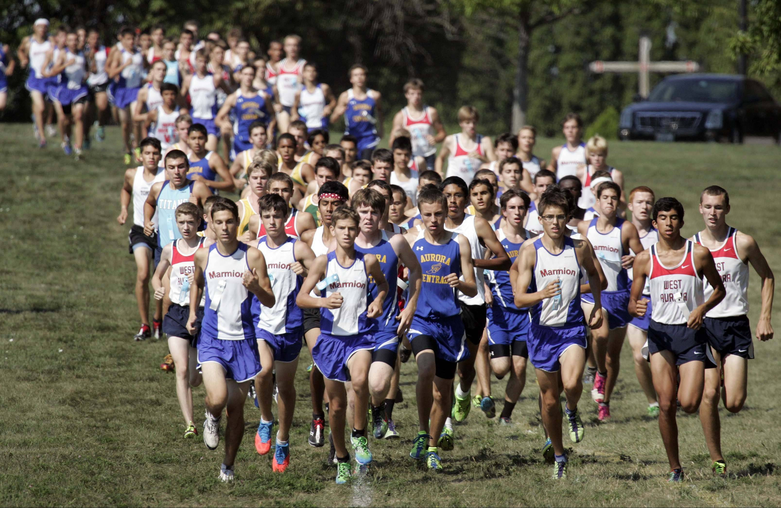 Runners take off at the start of the boys varsity race.