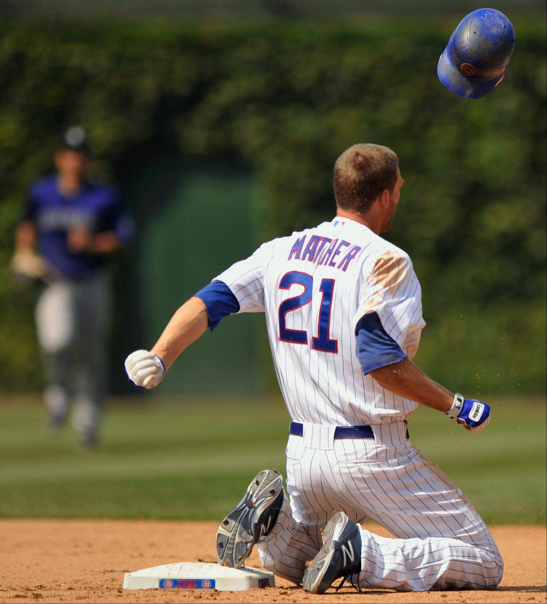 The Cubs' Joe Mather throws his helmet after being caught stealing at second base in the seventh inning Saturday at Wrigley Field, a play that manager Dale Sveum said proved extremely costly.