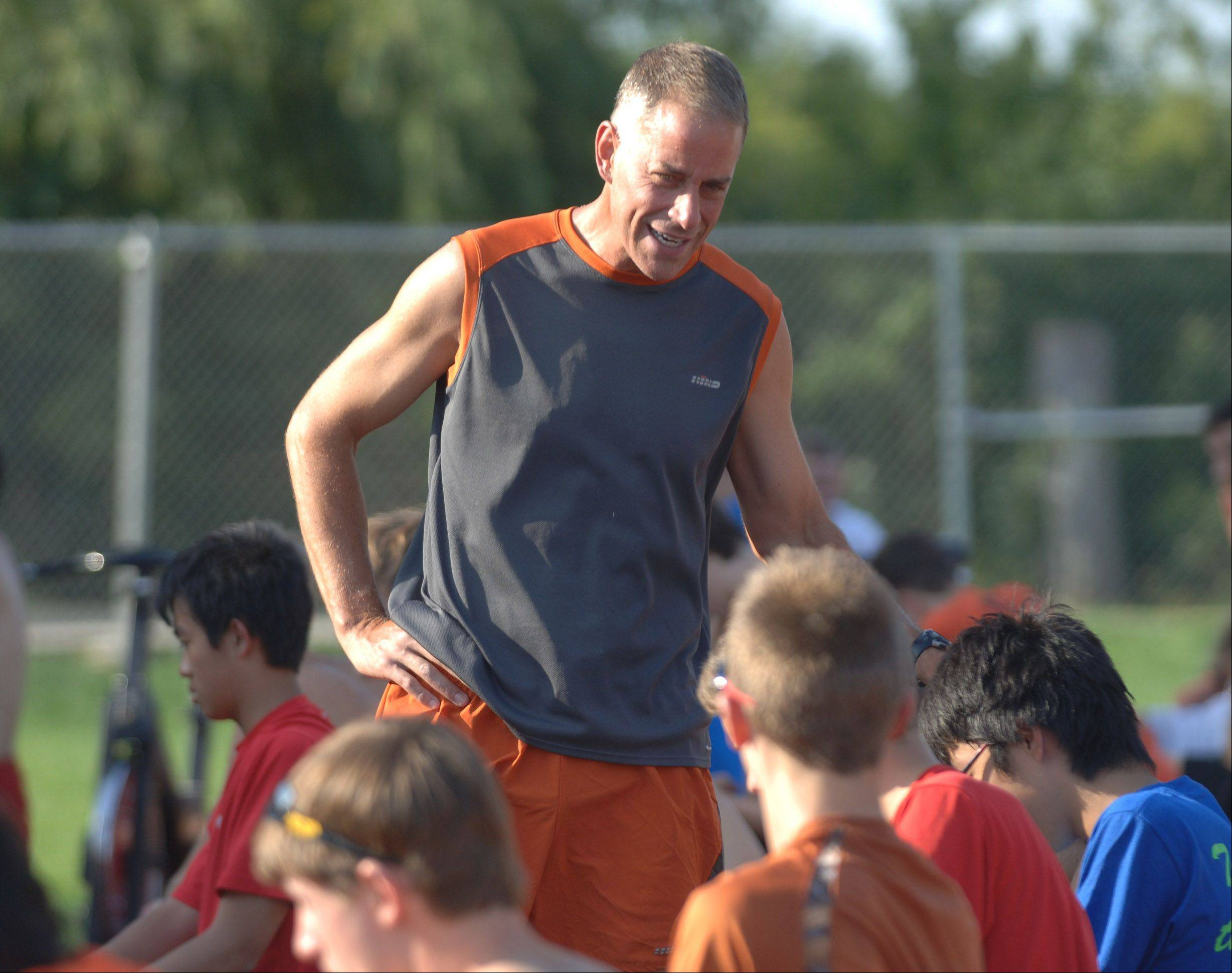 Libertyville High School cross country coach Mark Buesing talks with the runners Thursday.