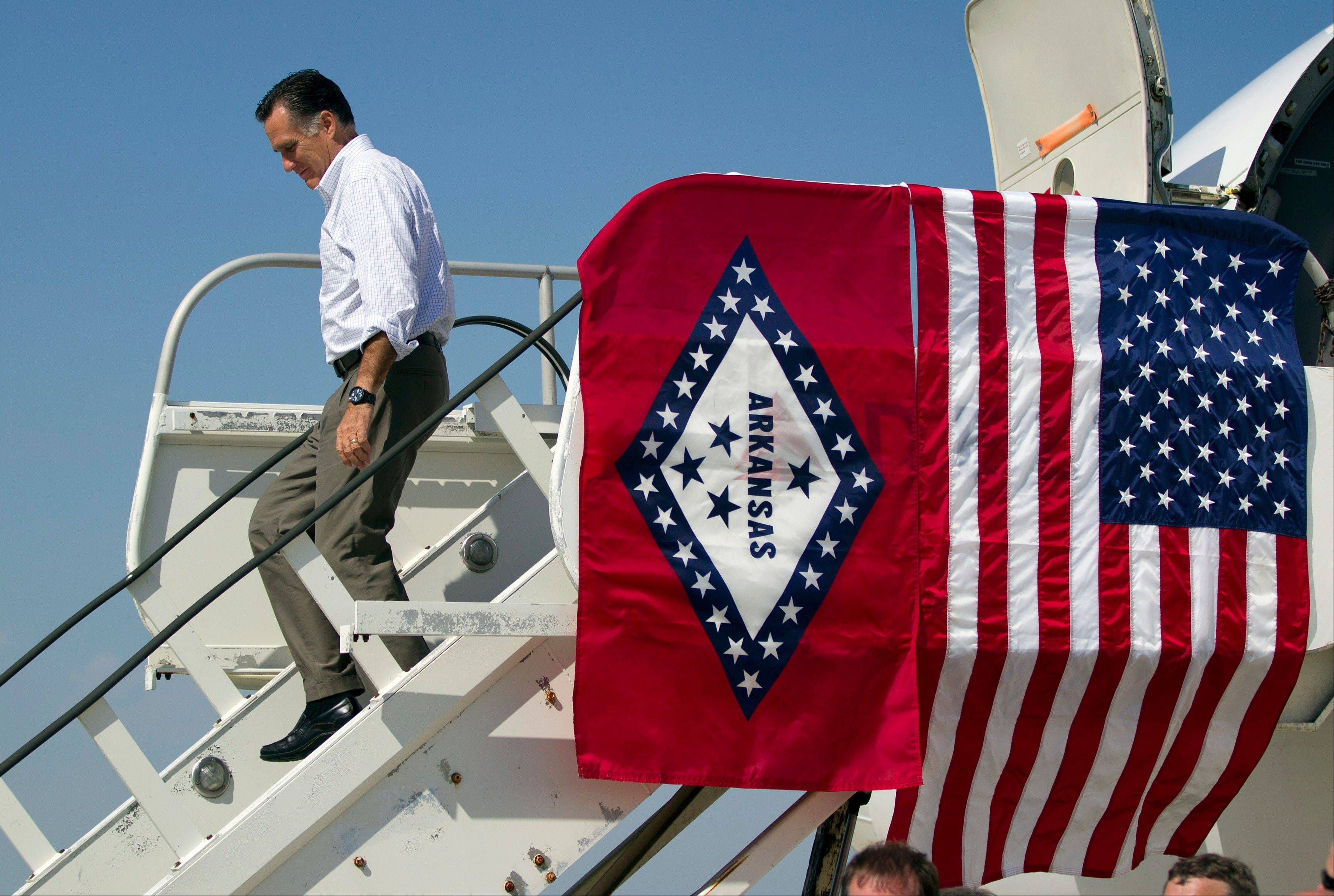 Republican presidential candidate, former Massachusetts Gov. Mitt Romney arrives at Adams Field Airport for a fundraising event on Wednesday, Aug. 22, 2012 in Little Rock, Ark.