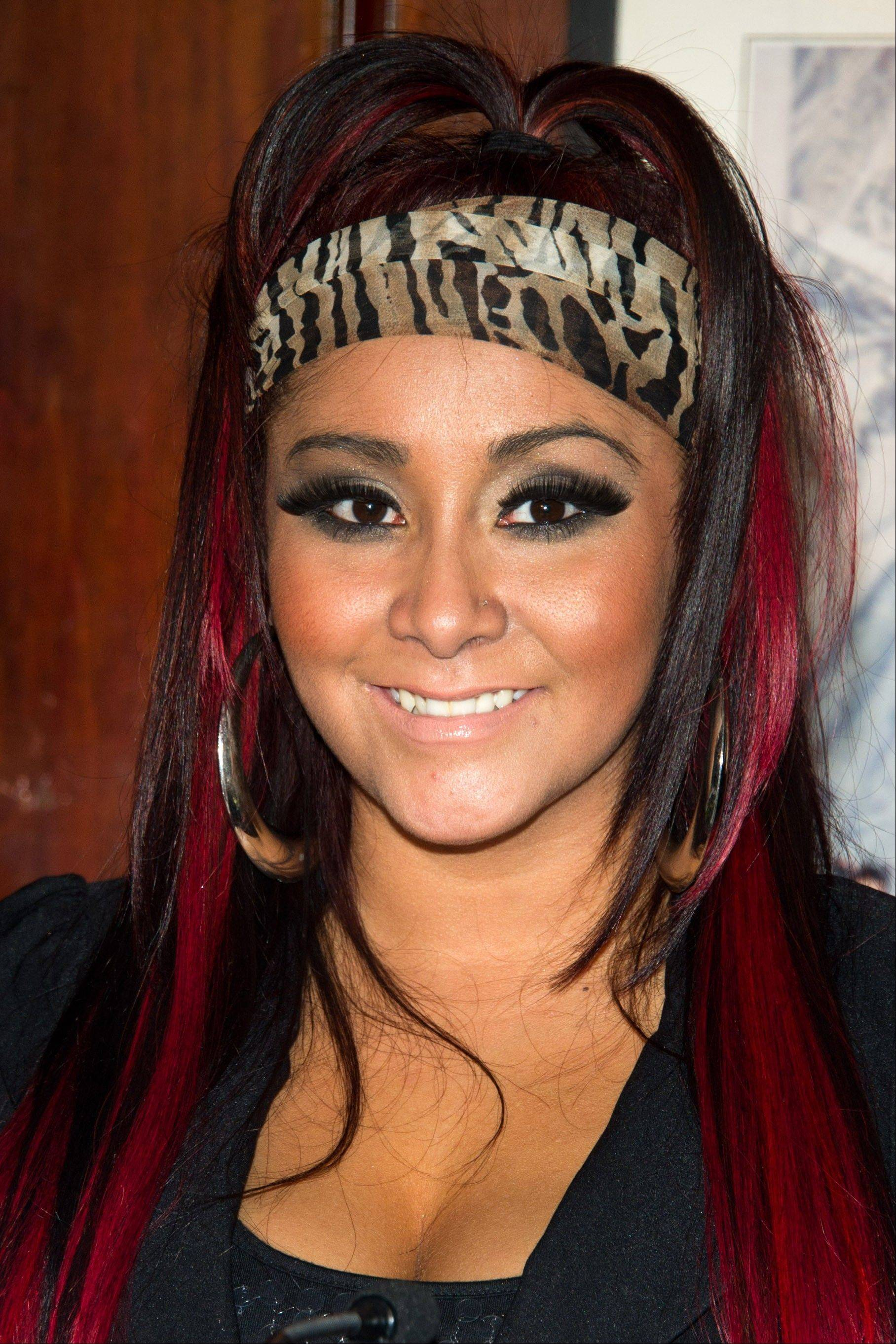Nicole �Snooki� Polizzi attends a press event to announce her new venture, Team Snooki Boxing and the upcoming boxing matches featuring Ireland�s Hyland brothers, in New York, in this Jan. 12, 2012 file photo. Snooki gave birth to her first child early Sunday morning at Saint Barnabas Medical Center in Livingston N.J. according to MTV. A baby boy weighing 6lbs, 5oz.