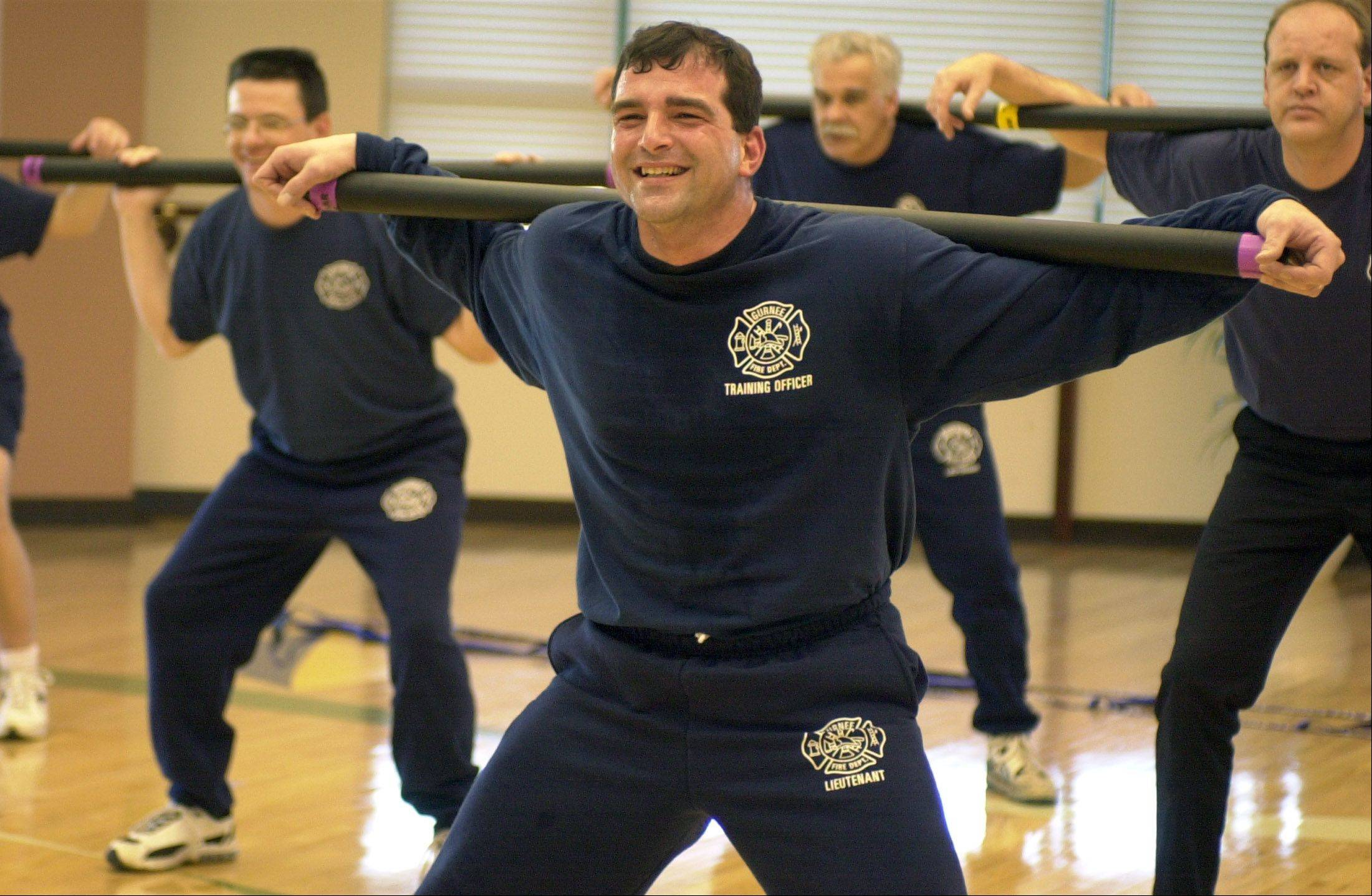 James Pellitteri, center, has handled a variety of duties as a Gurnee firefighter/paramedic, including this work as a training officer during a fitness and nutrition program in 2002.