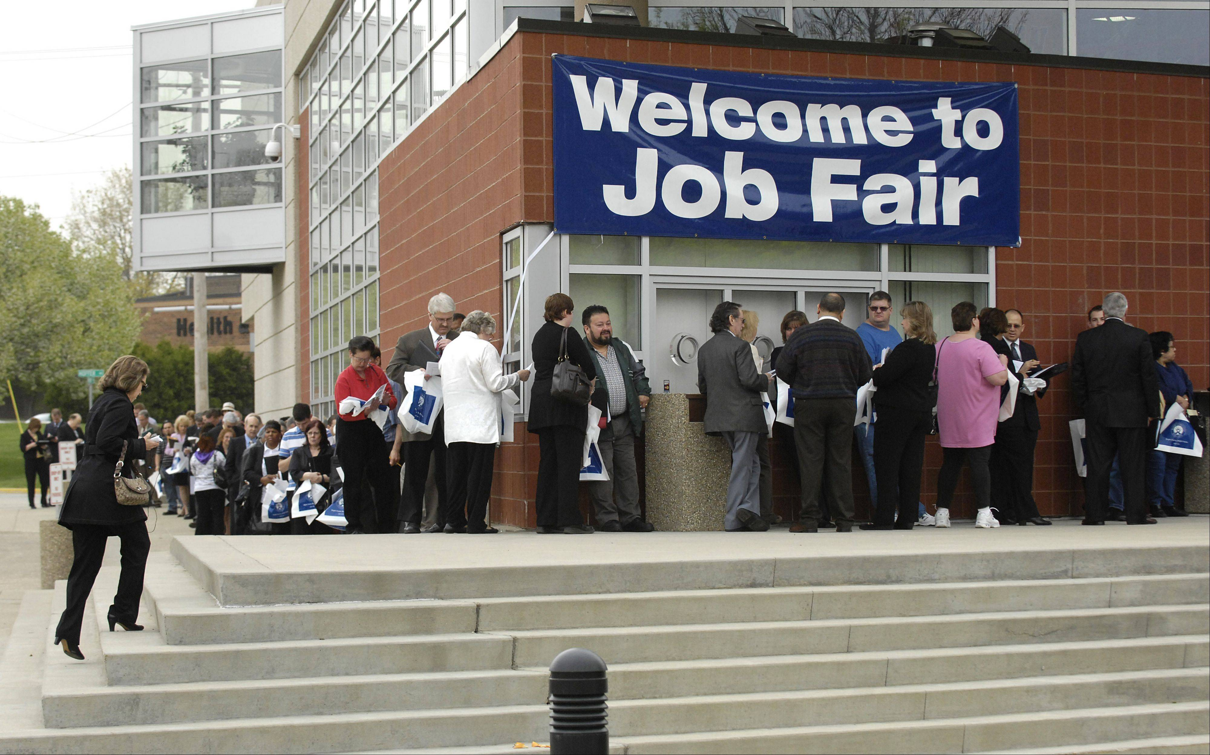 People line up before the start of the Elgin Community College Job Fair in April.