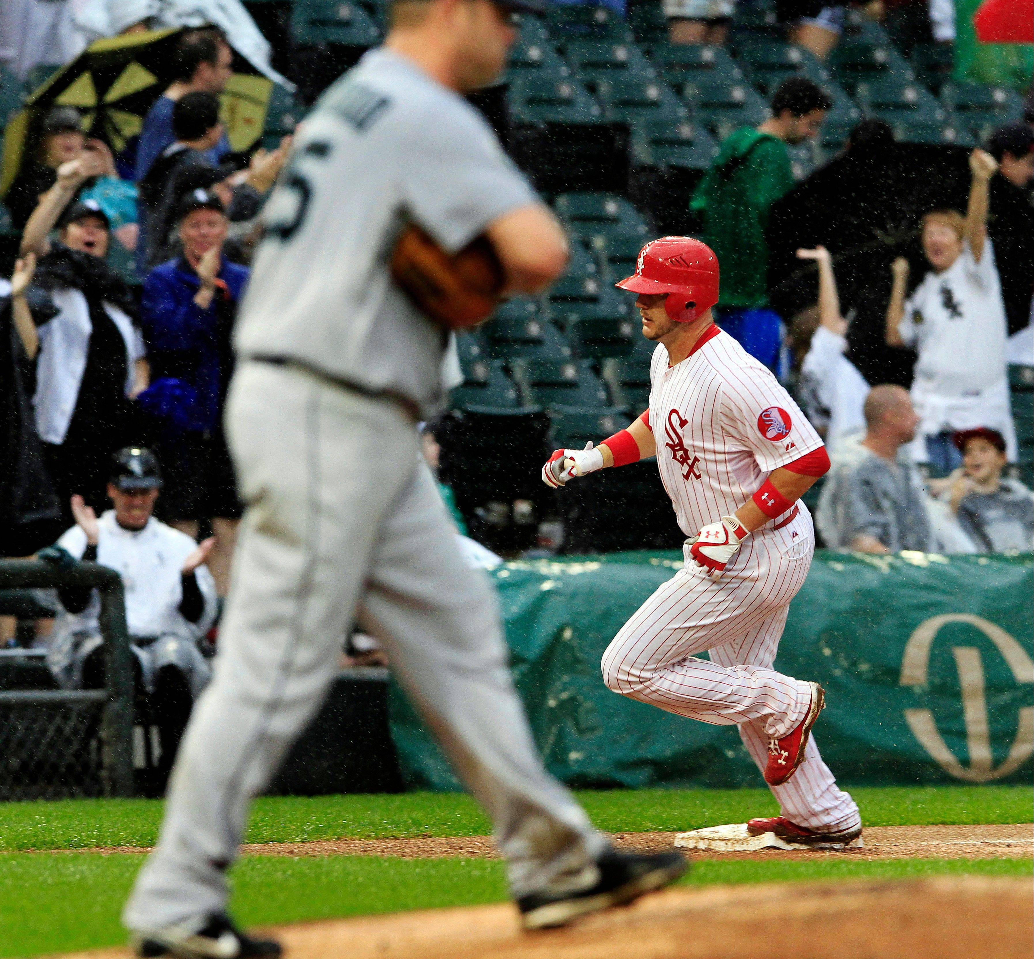 White Sox catcher Tyler Flowers rounds third after hitting what proved to be a game-winning 2-run homer off Mariners pitcherKevin Millwood in the seventh inning Sunday at U.S. Cellular Field.