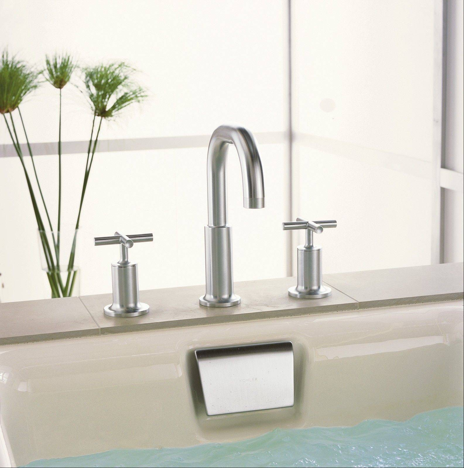 Tub fillers can look and operate like a regular two-handle bathroom faucet. But as you noticed, they're usually larger than a standard sink faucet.