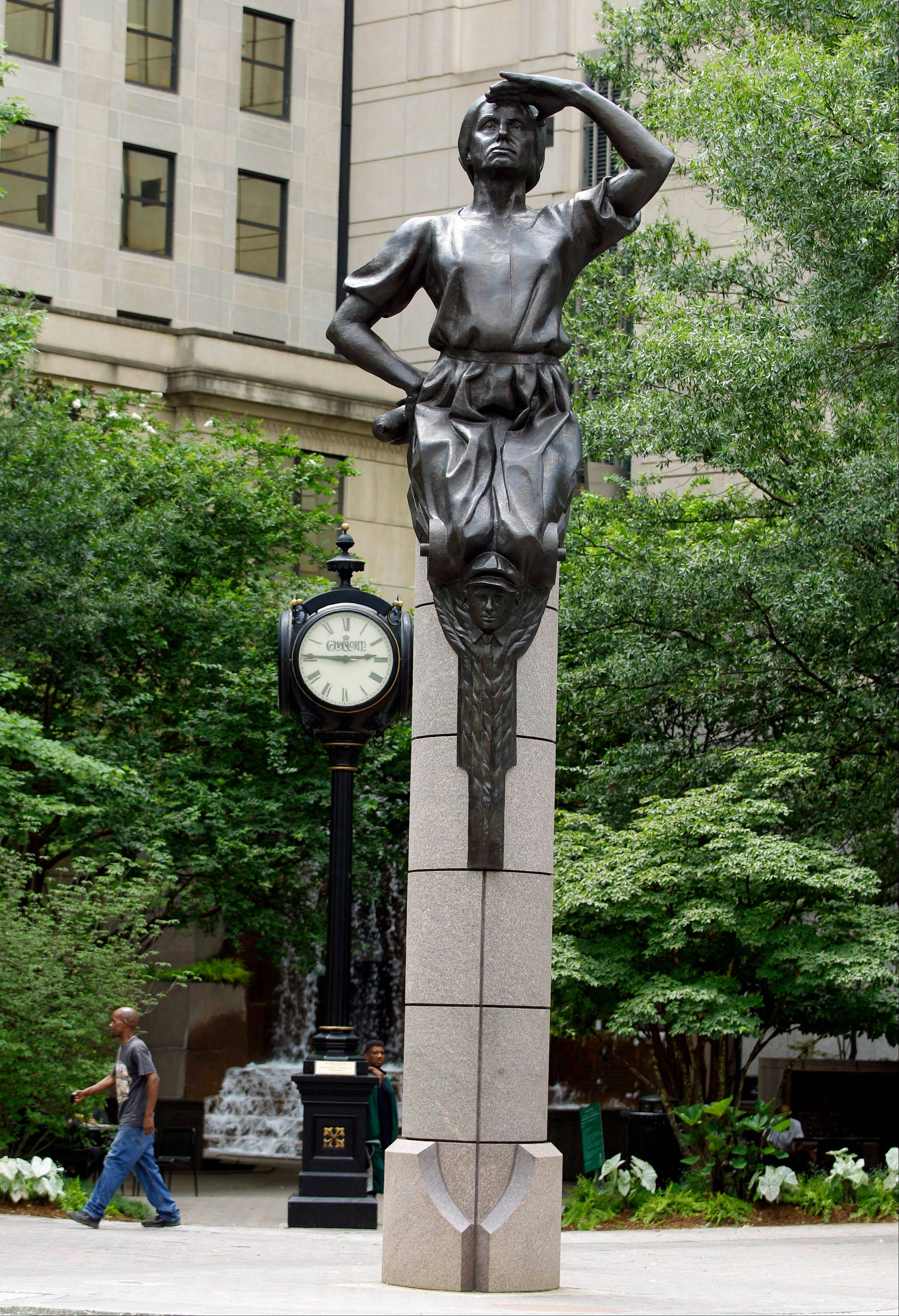 A statue at Independence Square in downtown Charlotte, N.C., is one of four bronze statues at the intersection representing commerce, transportation, energy and the future.