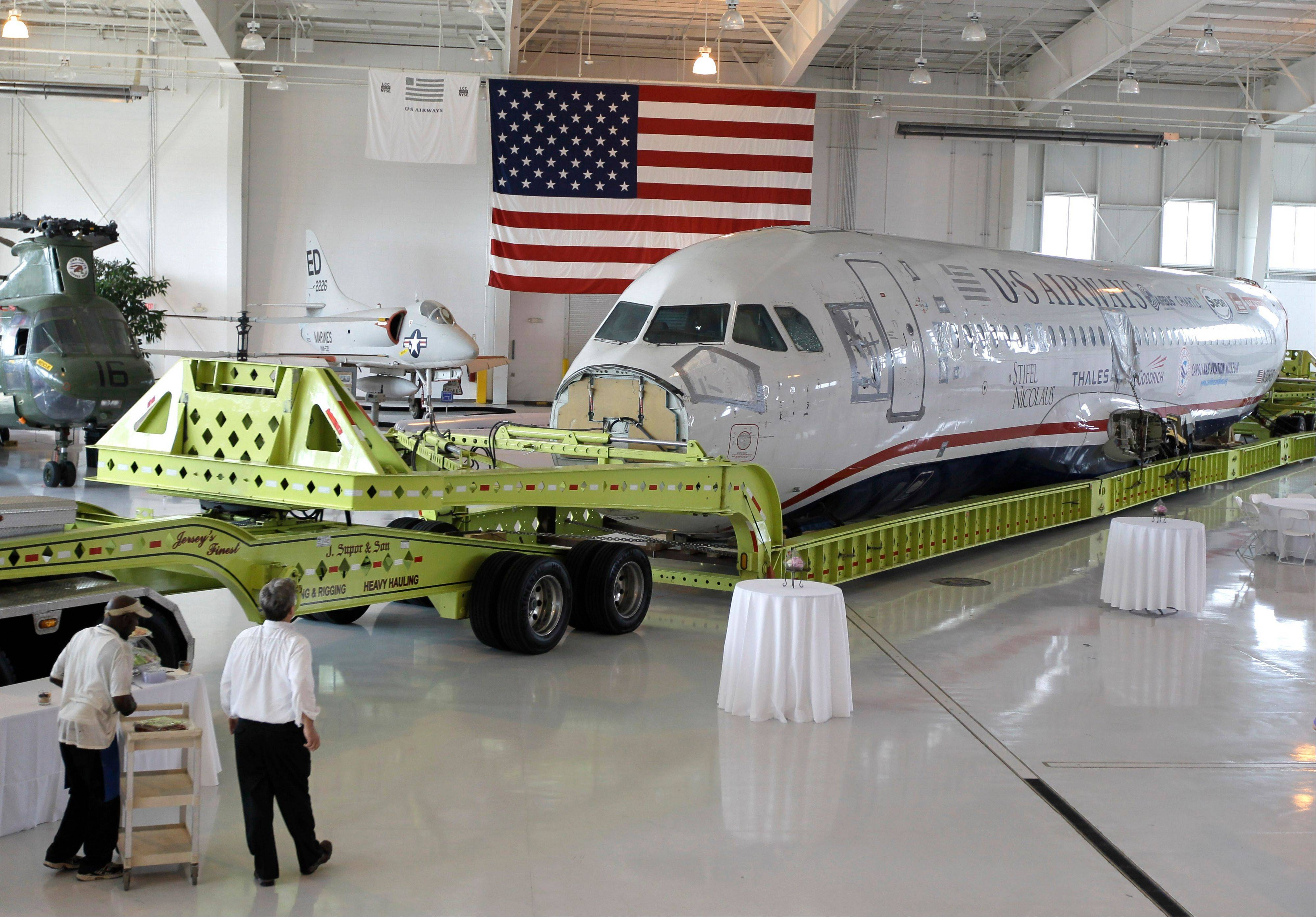 The fuselage of US Airways flight 1549 aircraft rests inside at the Carolina Aviation Museum in Charlotte, N.C. The plane that made a miraculous landing on the Hudson River two years ago will be displayed in the museum in Charlotte.