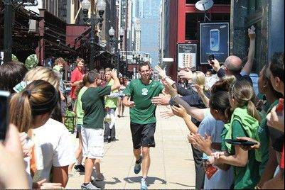 Roosevelt University Athletic Director Mike Cassidy of Wheaton runs to finish his 27.8-mile marathon from the school's Schaumburg campus to its new 32-story facility in Chicago. He has to catch the men's team inaugural soccer game in the afternoon.