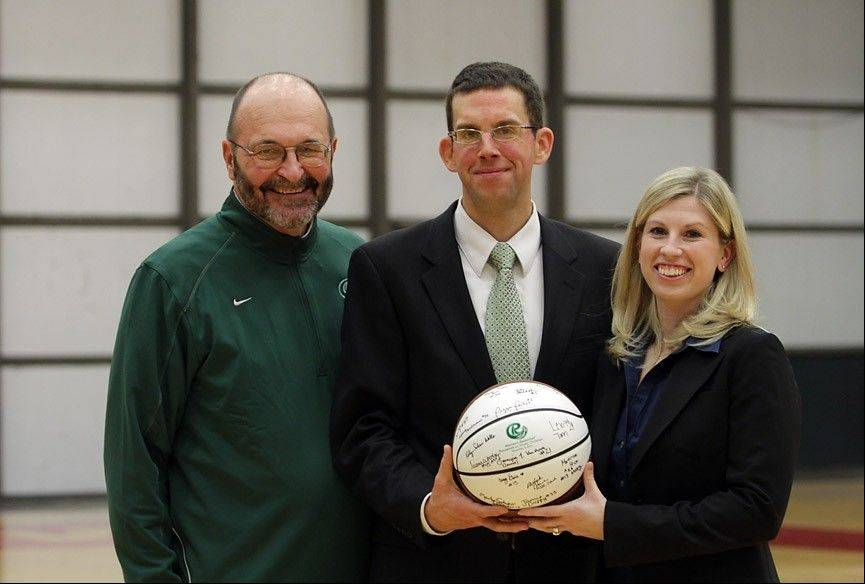 Praising the help he gets from his wife, Maureen, and school officials such as provost Jim Gandre, Roosevelt University Athletic Director Mike Cassidy, center, is building a sports program from scratch.