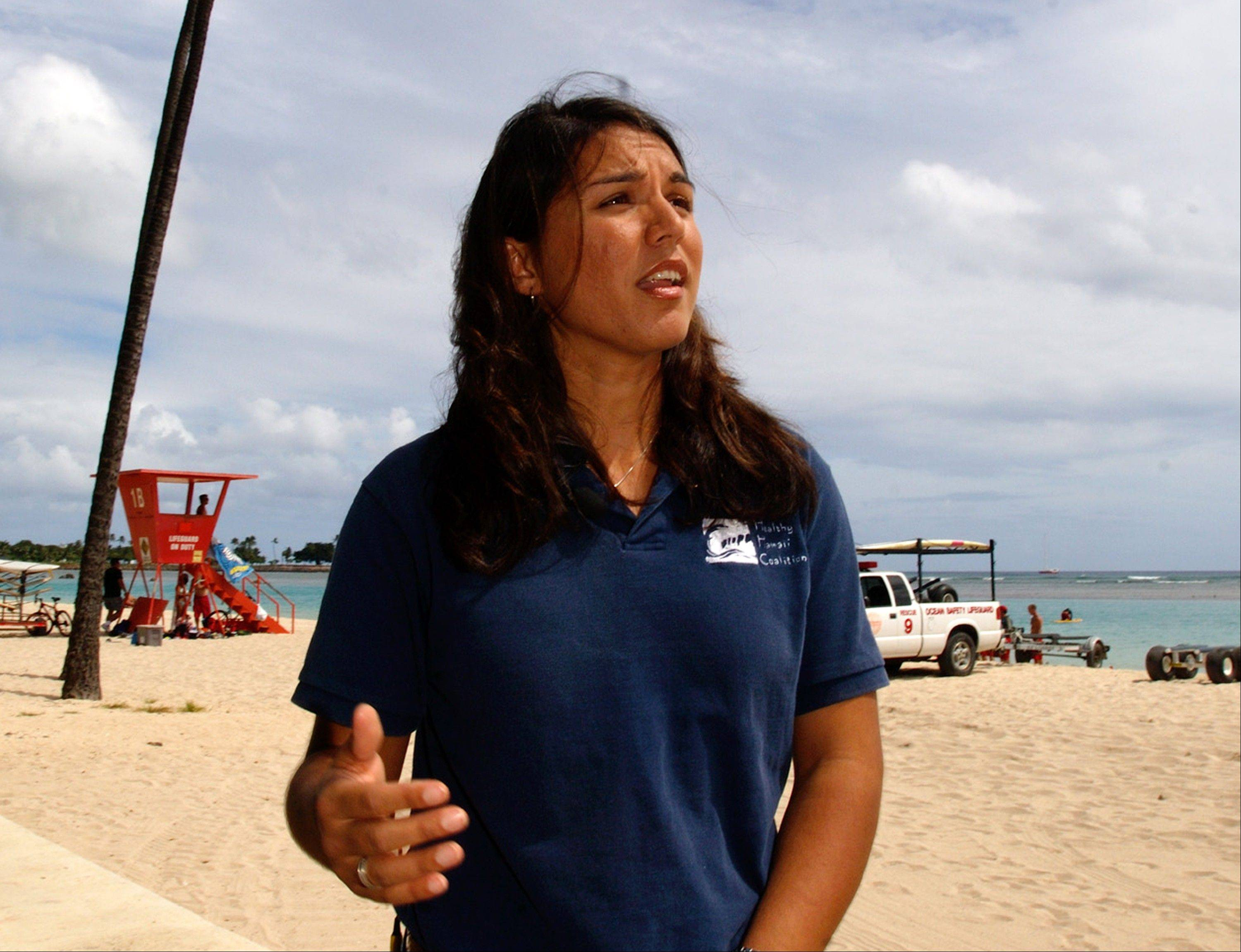 In this April 21, 2006 file photo, Tulsi Gabbard is seen on a beach near Waikiki in Honolulu. After more than a decade of wars in Iraq and Afghanistan, dozens of military veterans -- Republicans and Democrats -- are running for Congress this election year as voters have shown a fresh enthusiasm for candidates with no elected experience. This year, as the military has opened more jobs to women closer to the front lines, several of those veterans are females with battlefield scars and pioneering accomplishments.