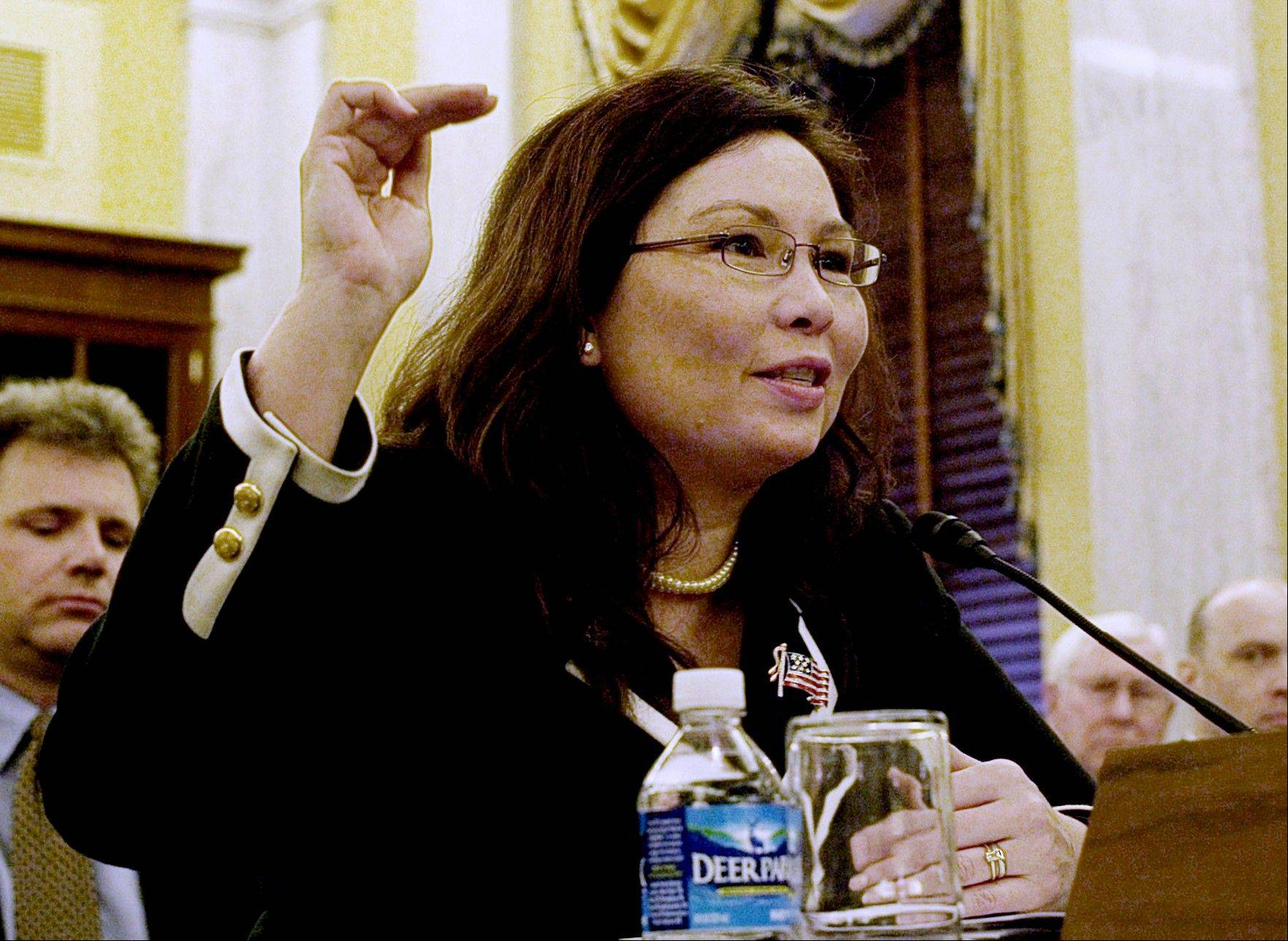 In this April 1, 2009 file photo, then-Assistant Veterans Affairs Secretary-designate Tammy Duckworth testifies on Capitol Hill in Washington. After more than a decade of wars in Iraq and Afghanistan, dozens of military veterans -- Republicans and Democrats -- are running for Congress this election year as voters have shown a fresh enthusiasm for candidates with no elected experience.