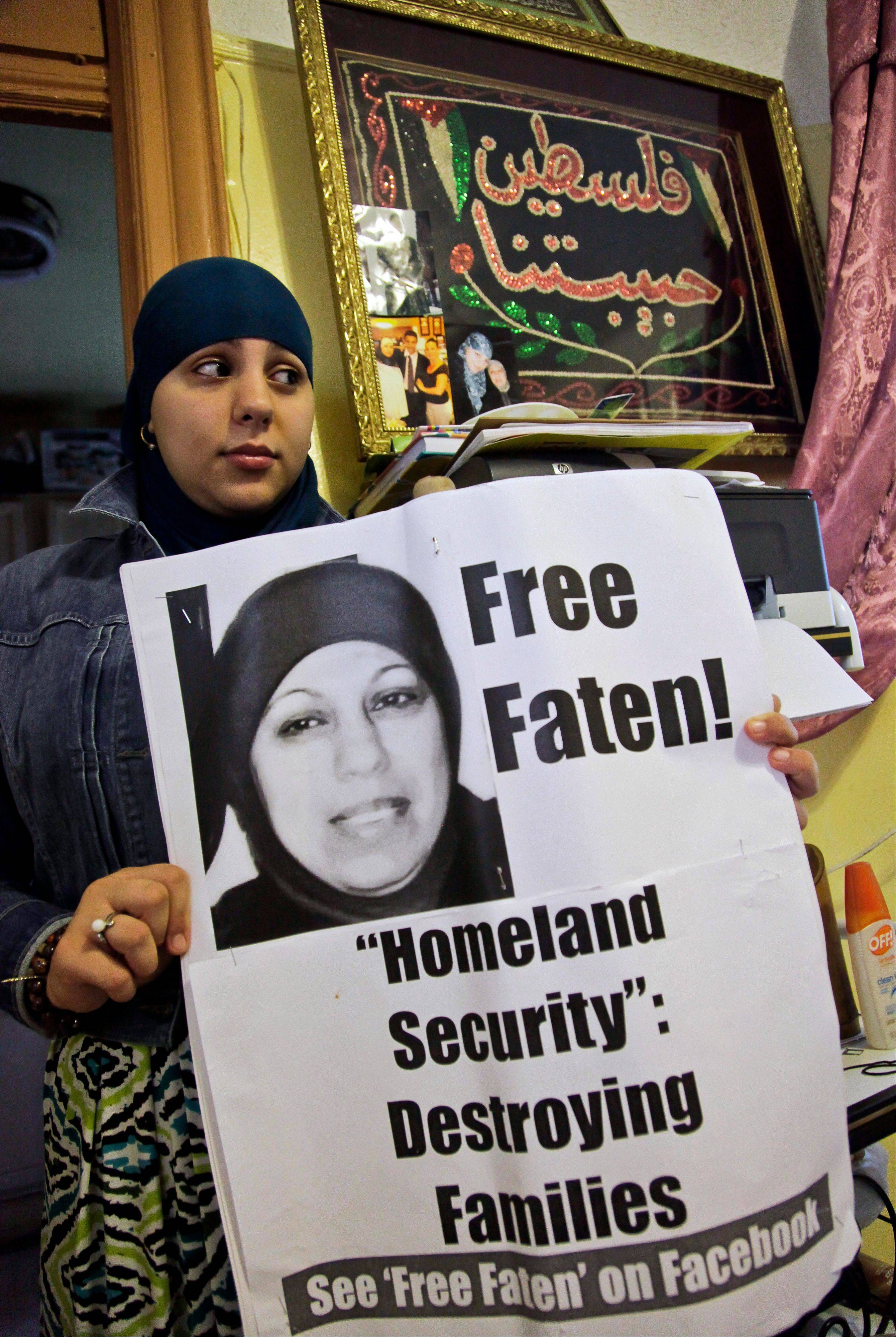 Janna Hakim, 18, shows a poster featuring a picture of her mother, Faten, who was taken away from her home in August 2010 by ICE officials and deported to Ramallah, Palestine. Janna has since engaged in public efforts to reunite the family.