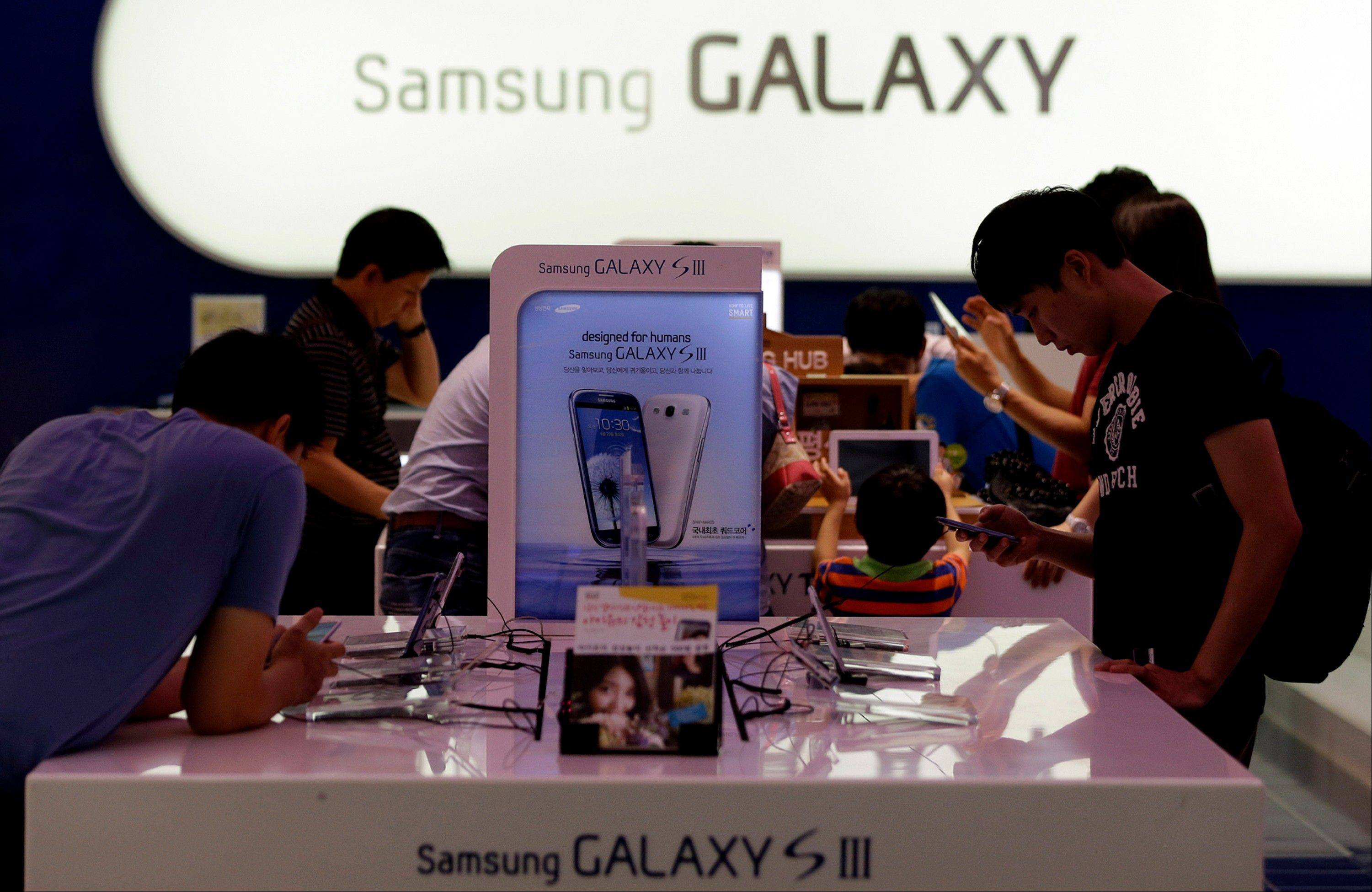 Visitors shop around Samsung�s smartphones at a shopping mall in Seoul, South Korea, Saturday, Aug. 25, 2012. The South Korean phone maker won a home court ruling Friday in its global patent battle against Apple and its popular iPhone and iPad devices. The ruling came hours before Apple prevailed in a similar case in the U.S. Judges in Seoul said Samsung Electronics Co. didn�t copy the look and feel of the iPhone and ruled that Apple infringed on Samsung�s wireless technology.