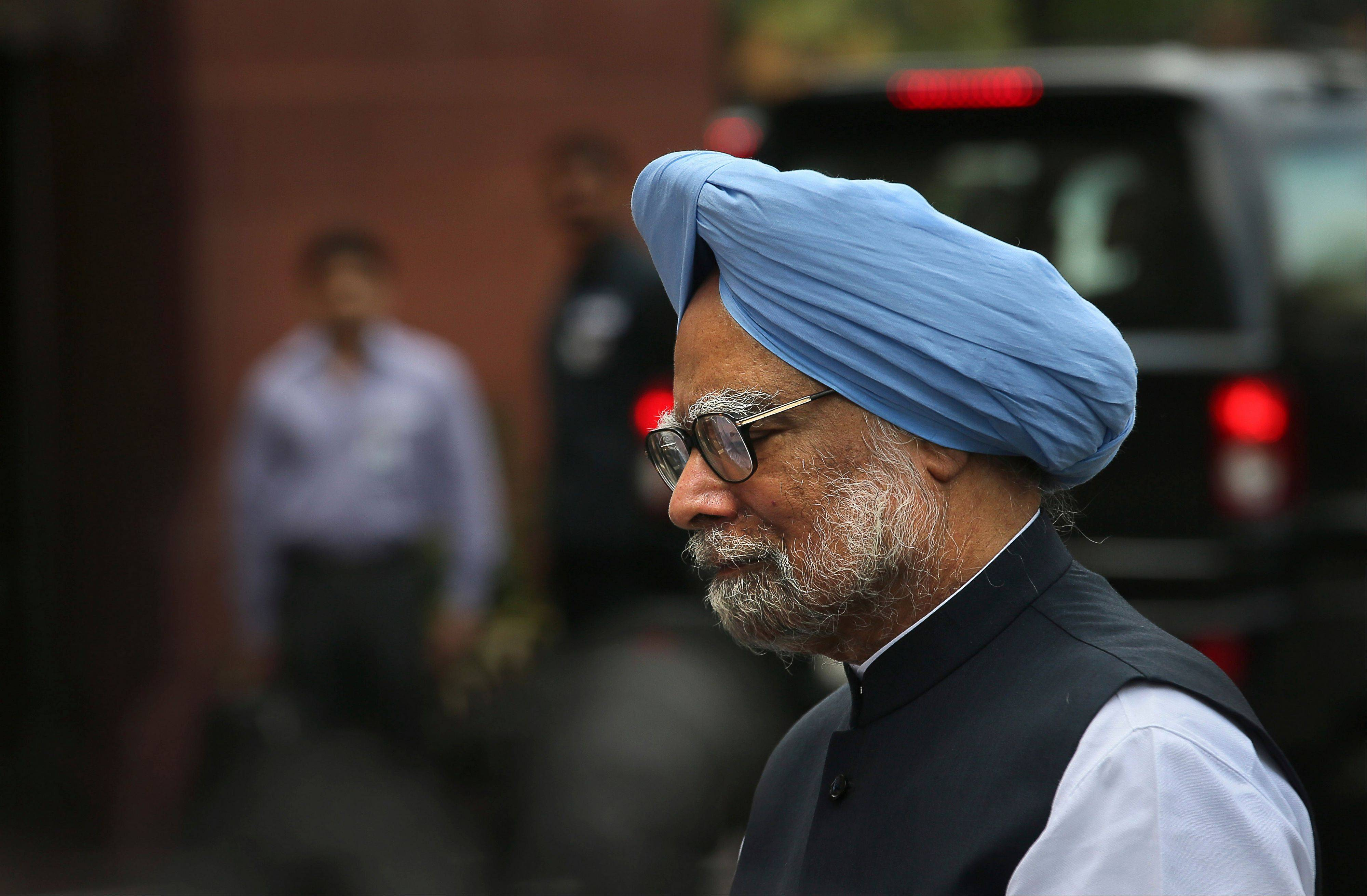 Indian Prime Minister Manmohan Singh leaves after making a statement to the media after he was shouted down by opposition politicians in the lower house of the Parliament, in New Delhi, India, Monday, Aug. 27, 2012. Singh took to Twitter on Monday to defend himself against a coal scandal roiling the country, saying accusations his government lost the country huge amounts of money were baseless.