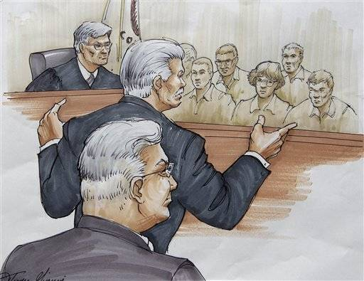In this courtroom sketch, Drew Peterson, foreground, looks on, as Will County State's Attorney James Glasgow gives his opening statement before Judge Edward Burmila and jurors, Tuesday, July 31, 2012, in Joliet, Ill., in Peterson's murder trial. Peterson is charged in the 2004 death of his third wife Kathleen Savio.