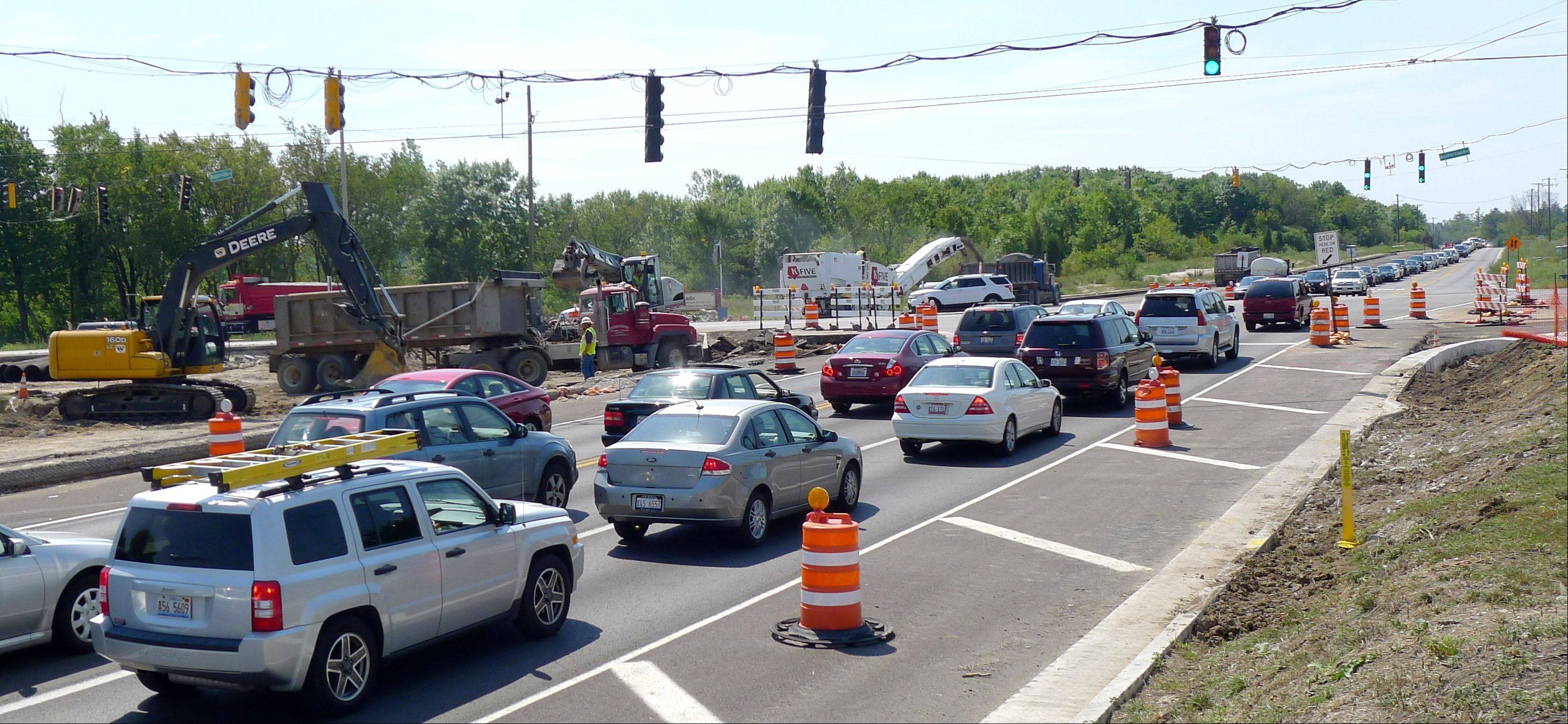 Construction is snarling traffic along portions of Butterfield Road, especially at the intersections of Naperville Road, shown here, and Winfield Road where vehicles heading north and south are being funneled into one lane in each direction.