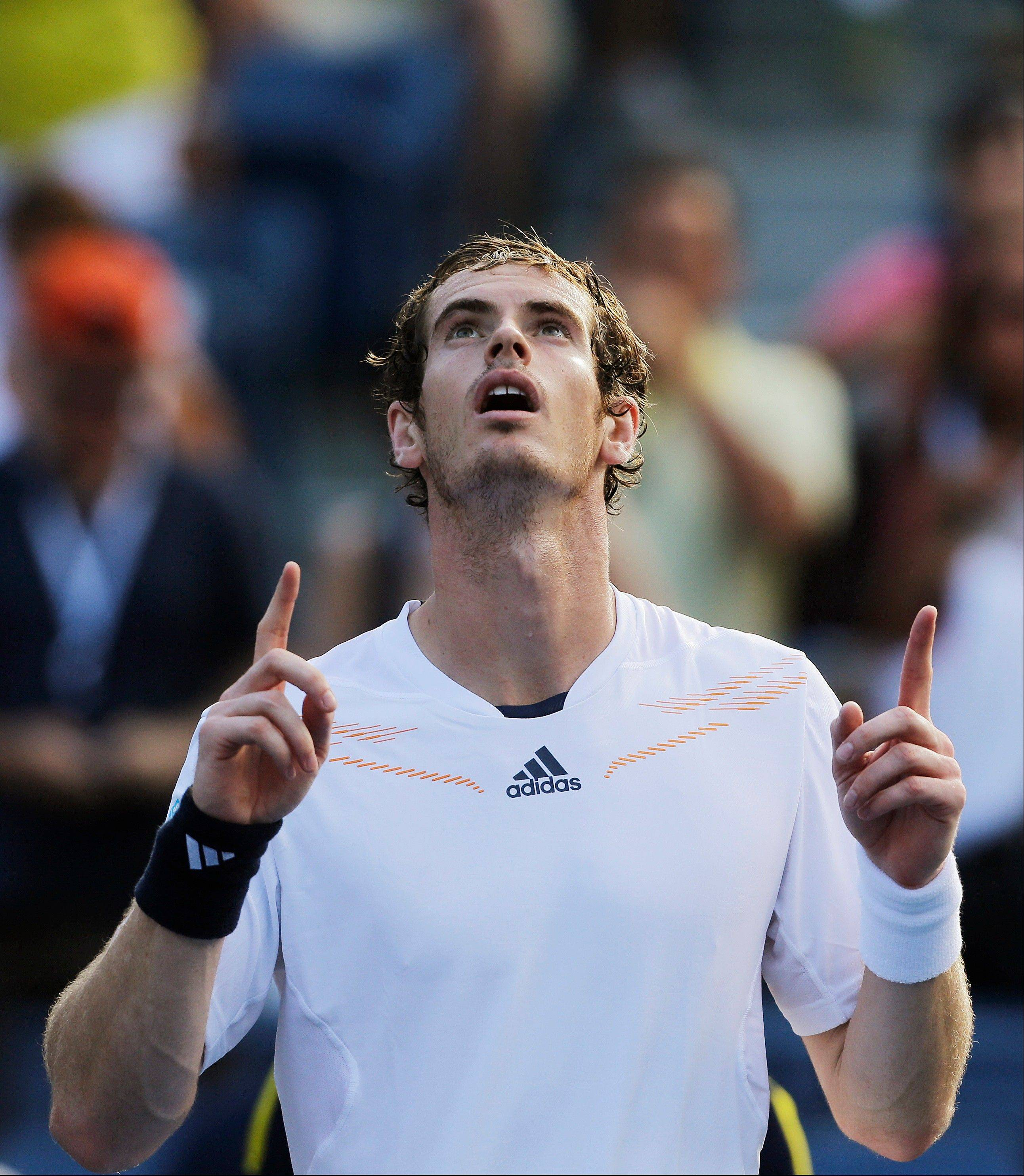 Britain�s Andy Murray celebrates after winning his match against Alex Bogomolov Jr. of Russia on Monday at the U.S. Open tennis tournament in New York.